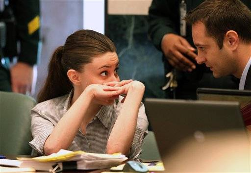 Casey Anthony talks to an unidentified man during her murder trial at the Orange County Courthouse Thursday.