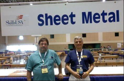 Elgin Community College student John Halwix of Marengo and Chuck Timm, an adviser to the ECC SkillsUSA team, check out the competition site in Kansas City, Mo. before the sheet metal national competition at which Halwix won a gold medal.