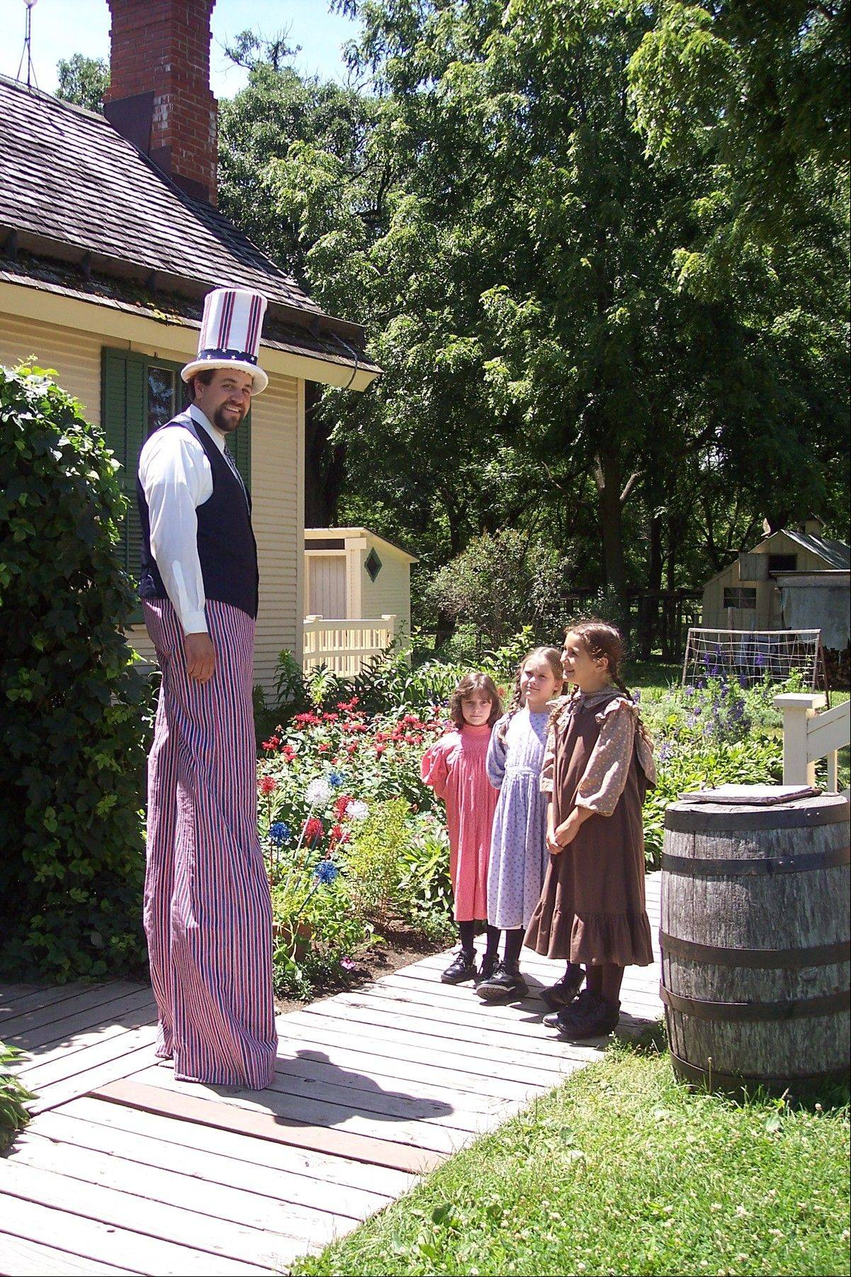 An Uncle Sam impersonator on stilts chats with costumed interpreters during a past Fourth of July Celebration at Kline Creek Farm. The 1890s farm provides a living history lesson for all who visit its grounds.