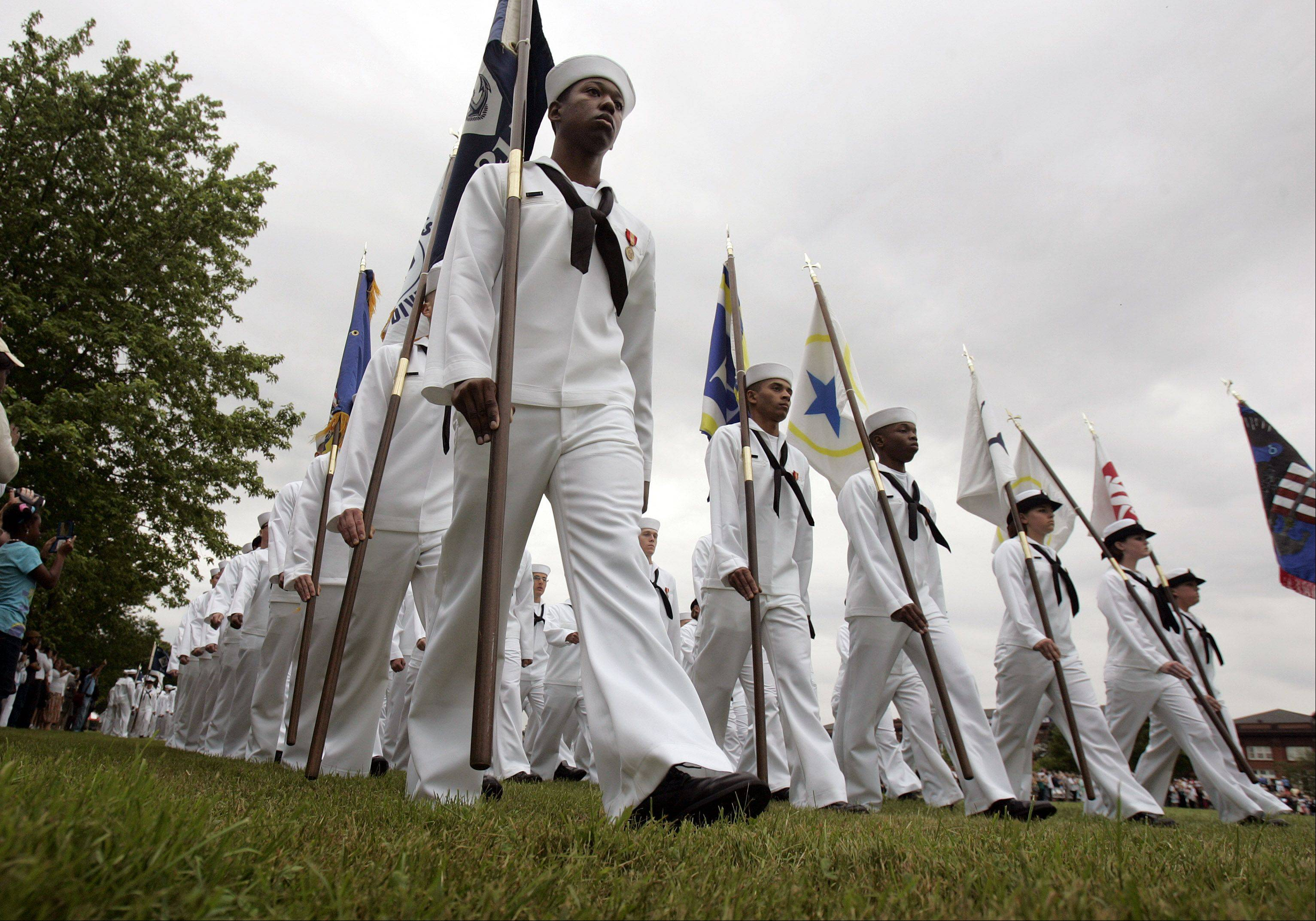 Nearly 800 recruits march onto Ross Field at Great Lakes Naval Station during graduating ceremonies Friday, the 100th anniversary of the base.