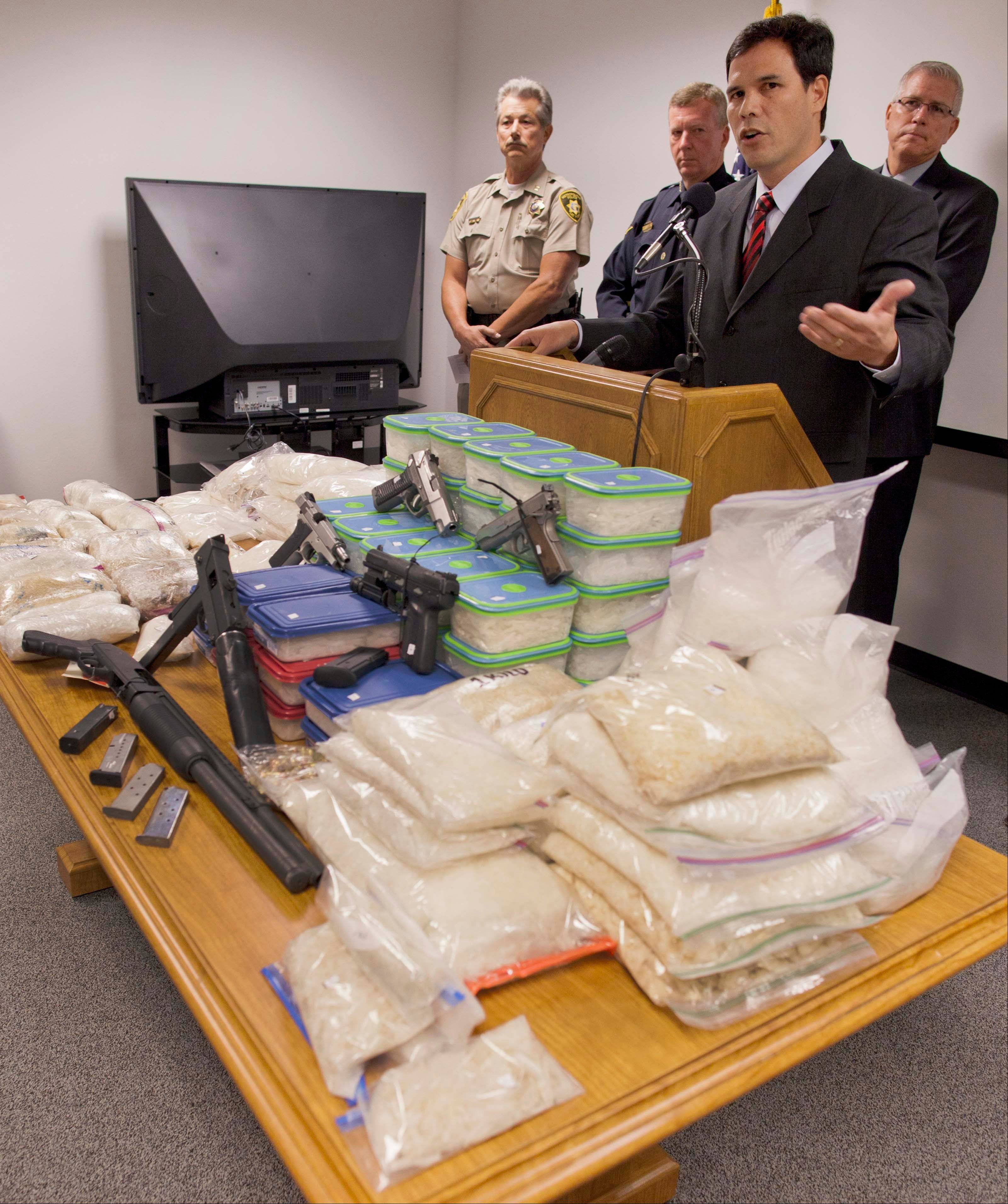 Drug Enforcement Agency assistant special agent Paul Rozario speaks during a news conference Thursday announcing the state's largest methamphetamine bust in history.
