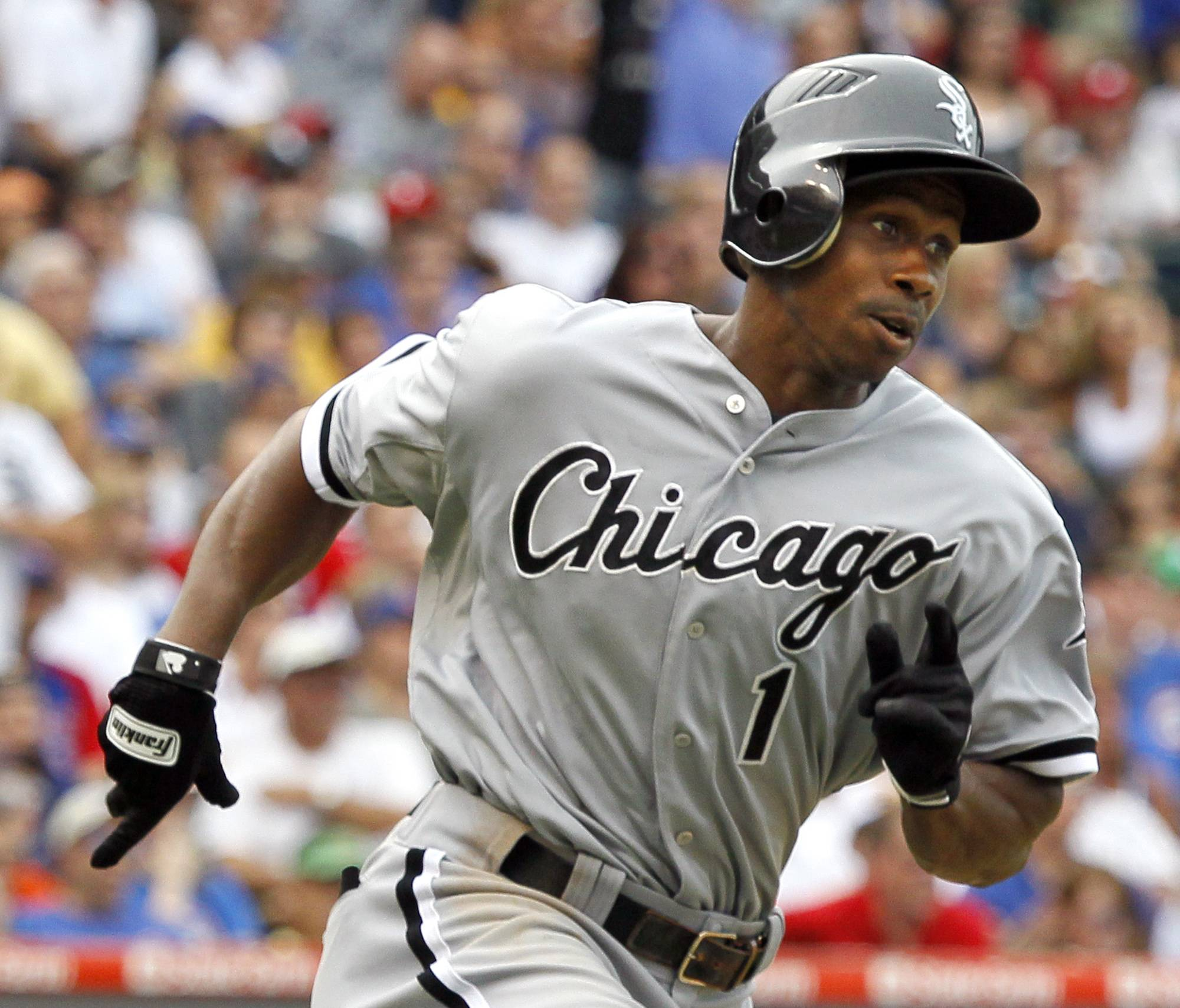 Juan Pierre rounds first after hitting a two-run triple off Cubs starting pitcher Randy Wells, scoring Alex Rios and Adam Dunn, during the seventh inning Friday at Wrigley Field.