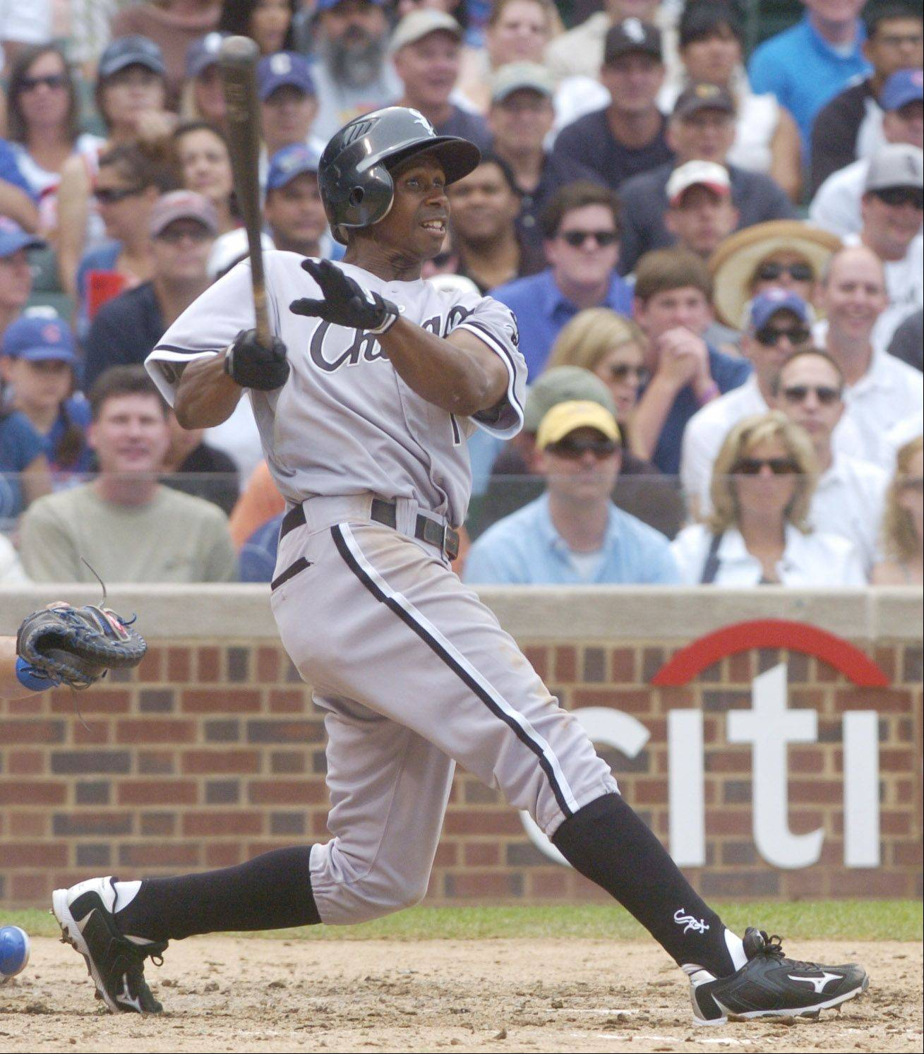 Juan Pierre hits a two-run triple during the four-run seventh against the Cubs Friday.