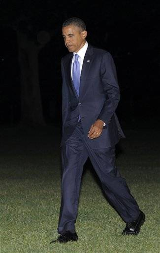 President Barack Obama walks off of Marine One on the South Lawn of the White House in Washington, Thursday, June 30, 2011, after returning from fundraising in Philadelphia.