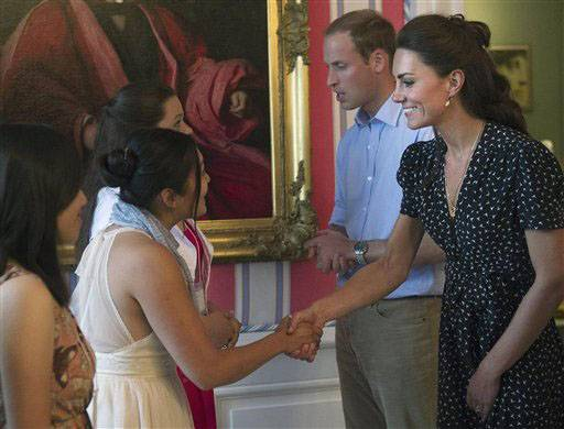 Prince William and wife Kate, the Duke and Duchess of Cambridge meet with people at a youth event in Ottawa, Ontario, on Thursday.