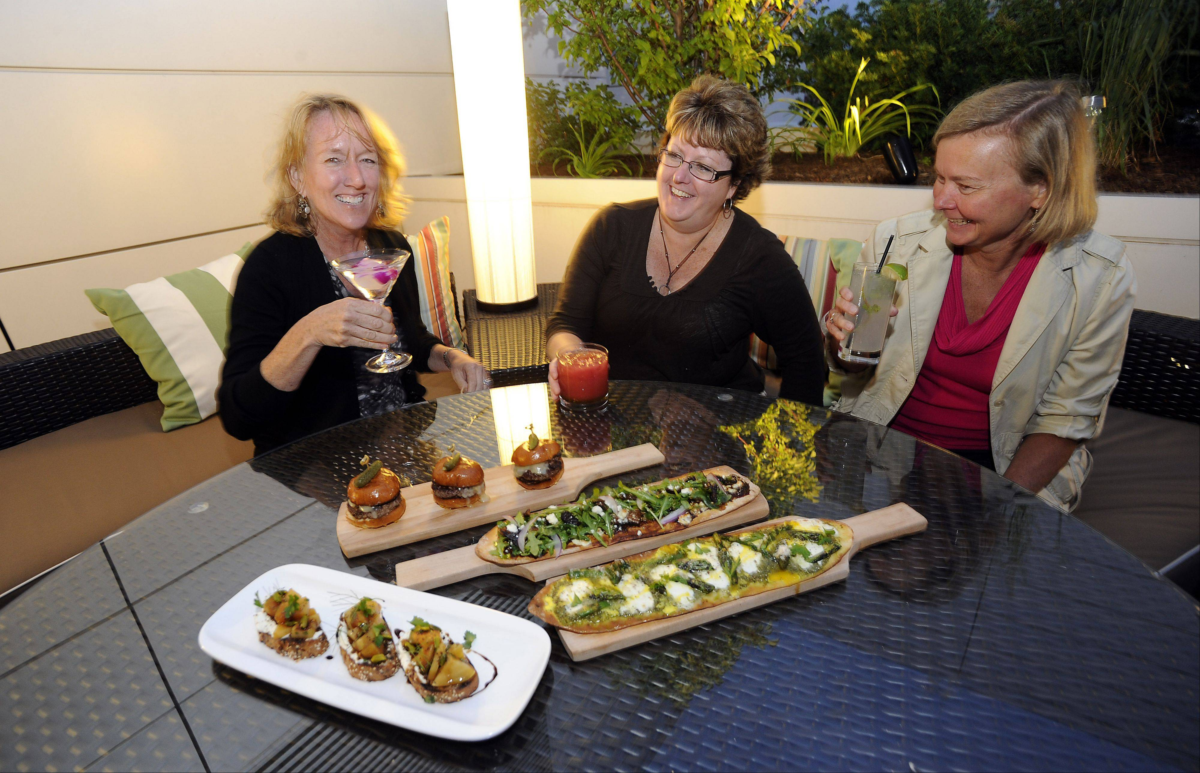 Mary Ellen Hogan of Arlington Heights, Alice Wimberly of Arlington Heights and Diane Heath of Elk Grove Village share a selection of drinks and appetizers at The Terrace.