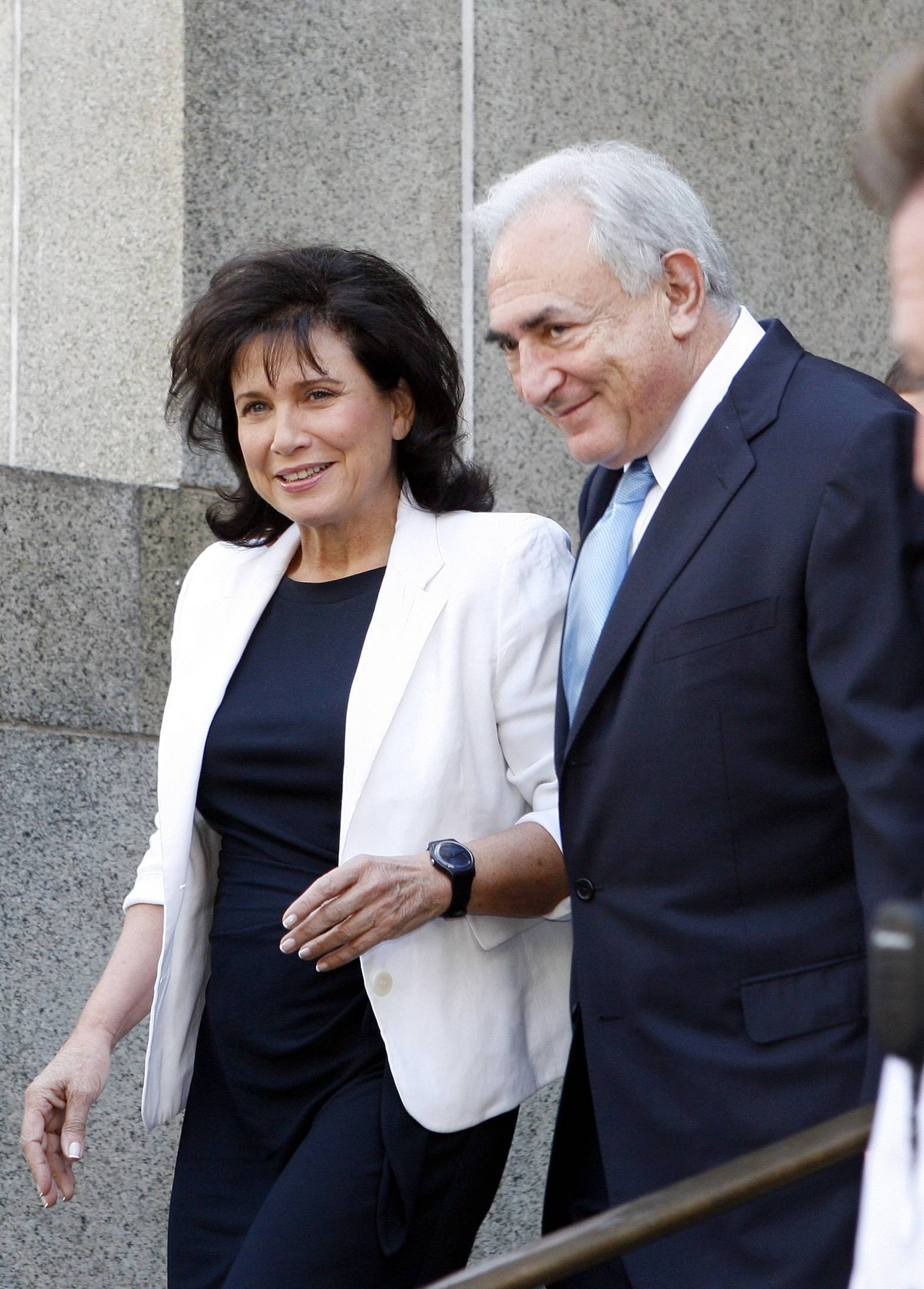 Dominique Strauss- Kahn leaves New York State Supreme court with his wife Anne Sinclair, Friday, July 1, 2011, in New York. A judge has agreed to free former International Monetary Fund leader Strauss-Kahn without bail or home confinement in the sexual assault case against him. The criminal case against him stands.