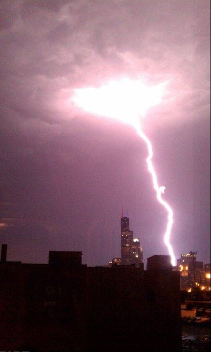Thursday night's storms brought fierce lightning to the Chicago area and golfball-sized hail. ComEd reports 93,000 people were without power.