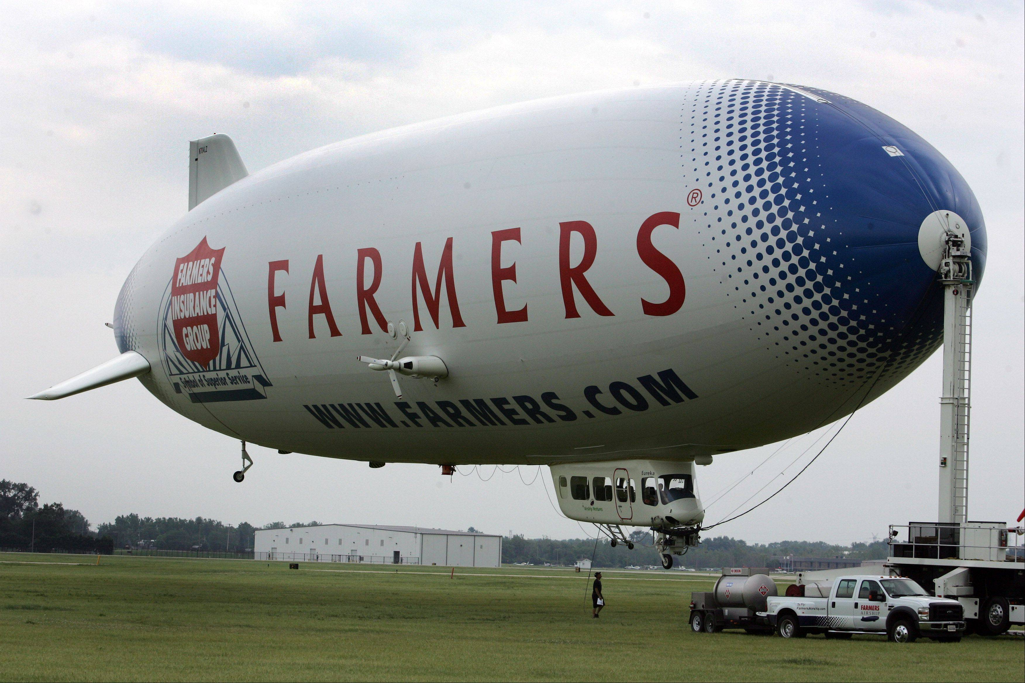 The Farmers Airship, one of only two Zeppelins currently flying globally, makes a stop at the DuPage County Airport in West Chicago. It is the largest passenger airship in the world, 15 feet longer than a Boeing 747 and 50 feet longer than the largest blimp.