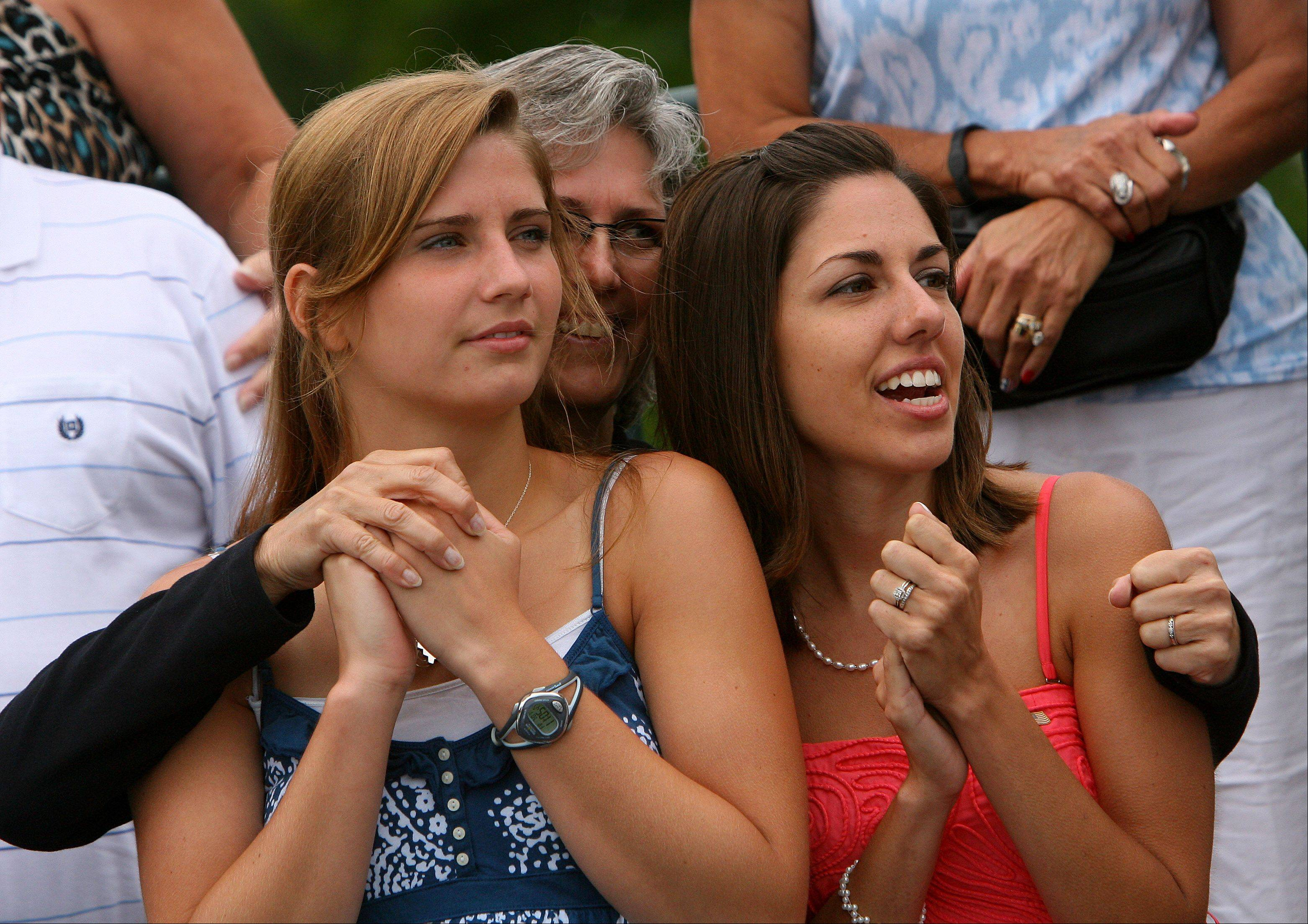 From left, Mary, Gayle and Jessica Seals watch graduation ceremonies at Great Lakes Naval Station Friday. About 1000 recruits graduated on the 100th anniversary of the base.