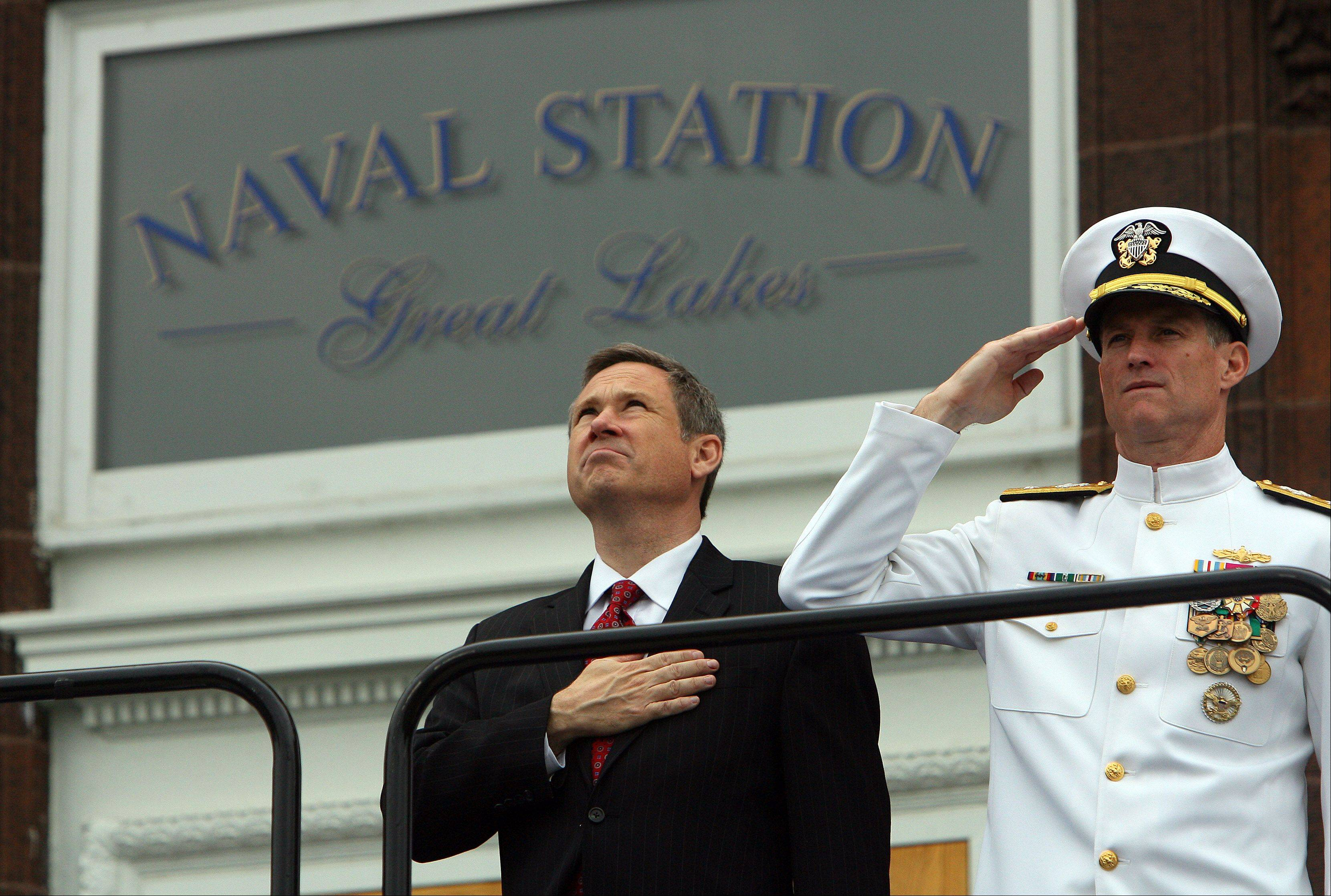 US States Senator Mark Kirk, left, stands at attention during the national anthem as Great Lakes Naval Station held a rededication ceremony while graduating about 1,000 recruits on its 100th anniversary. On his left is Rear Admiral Tilghman D. Payne, USN Commander, Naval Region Midwest.