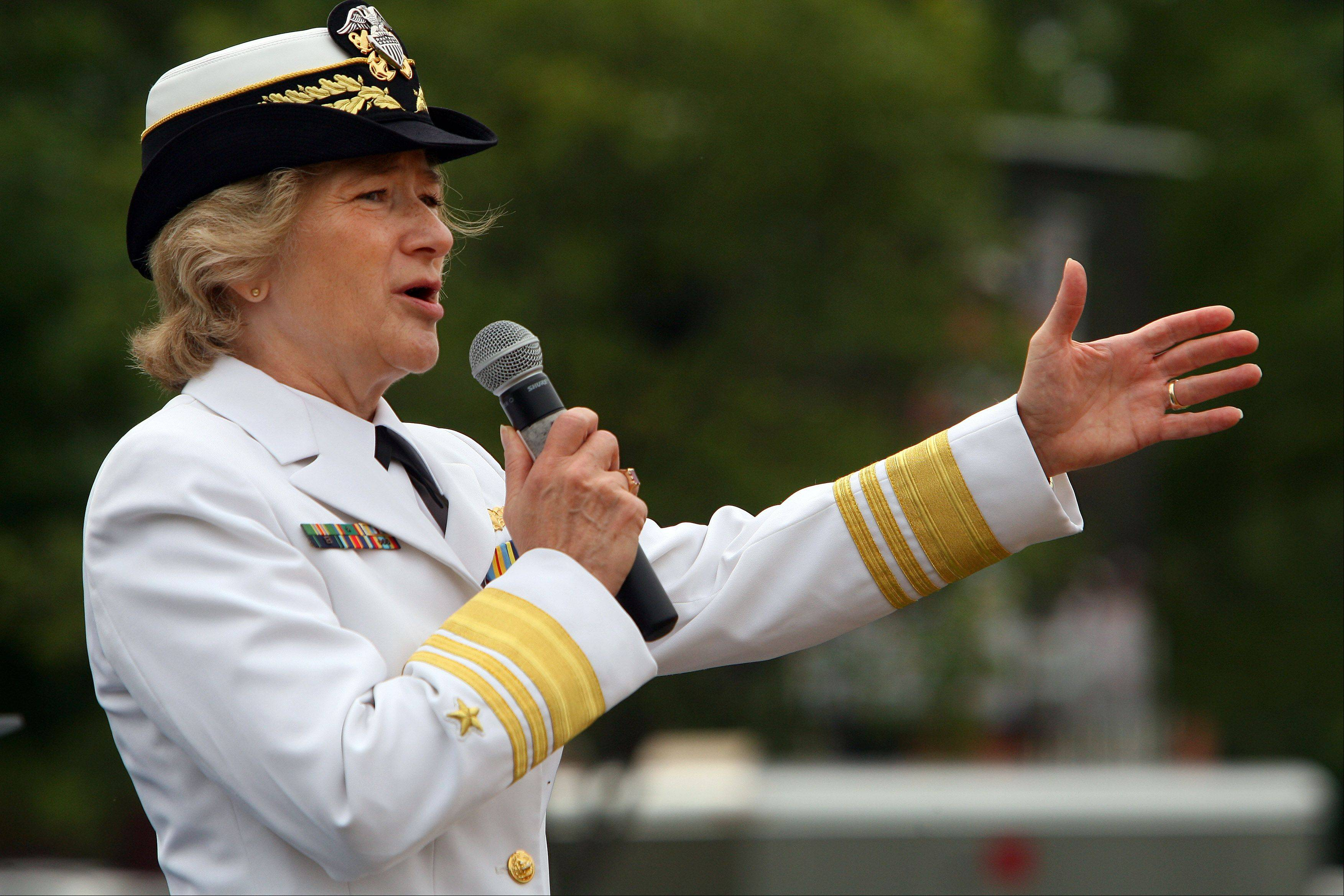 Vice Admiral Ann E. Rondeau gives a speech as Great Lakes Naval Station held a rededication ceremony while graduating about 1,000 recruits on its 100th anniversary.