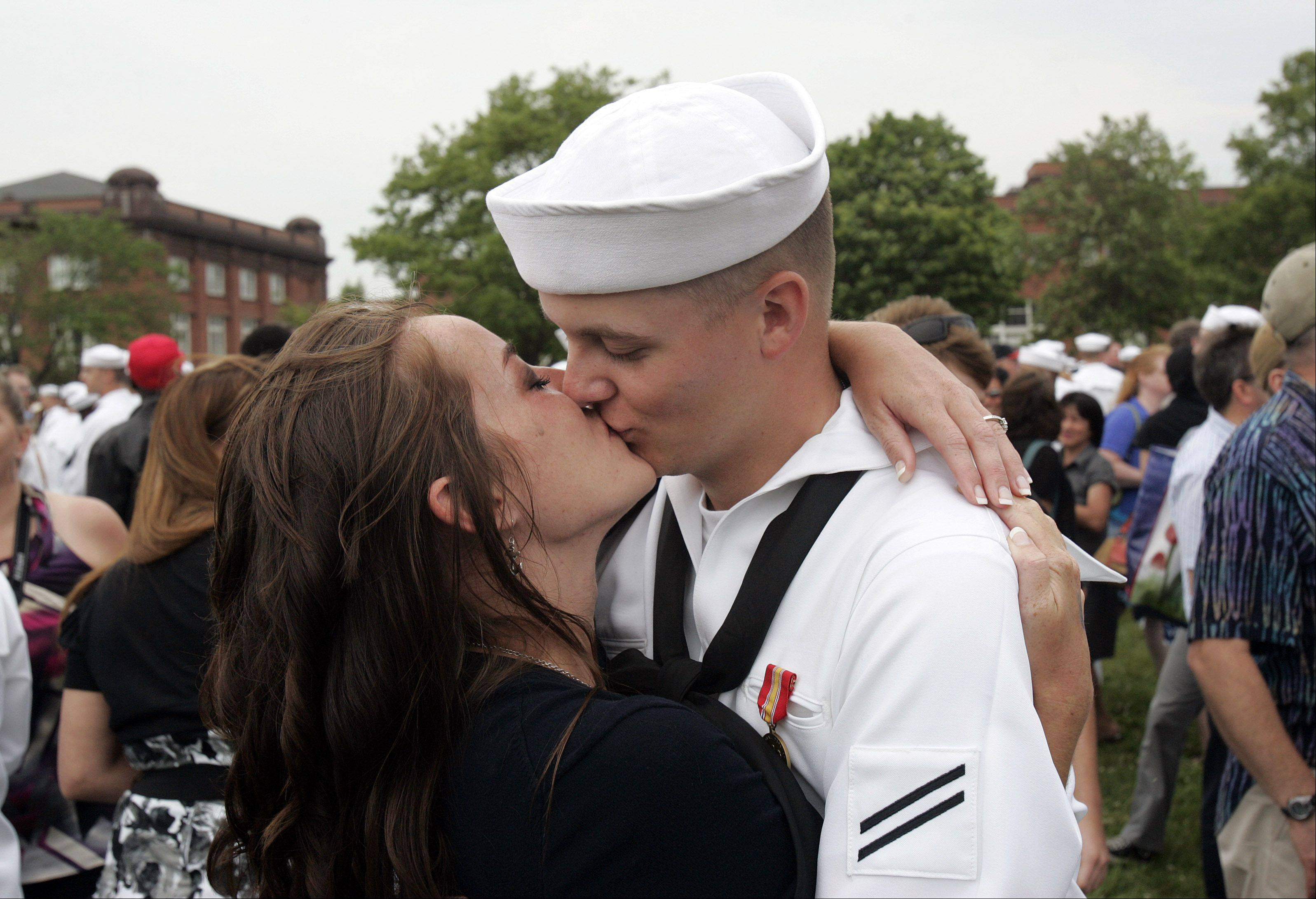 Jayson Cobb of Alabama hugs his fiance Haley Martin after graduation ceremonies at Great Lakes Naval Station Friday. Close to 800 recruits were minted as sailors on the base's 100th anniversary.