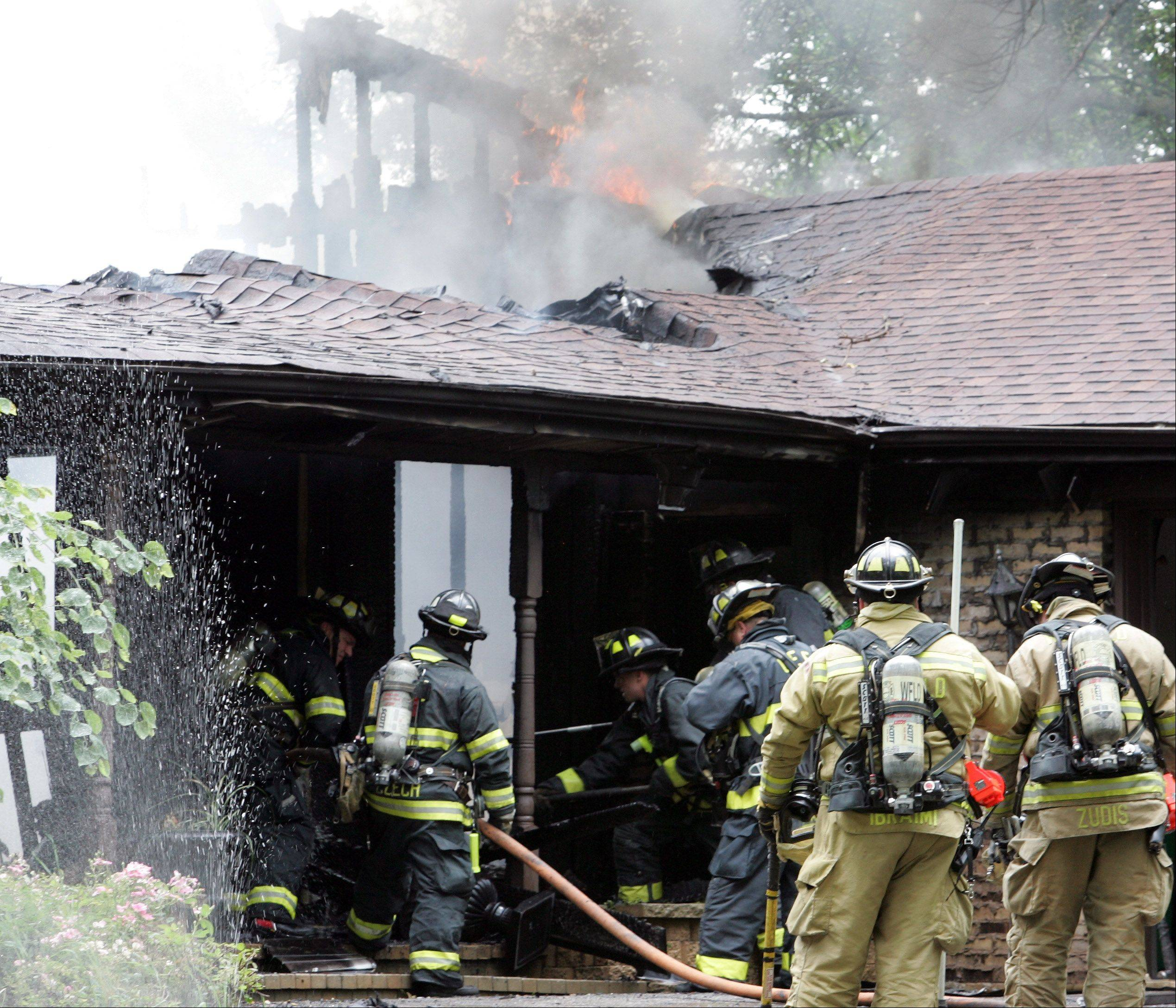 Homeowner John Chitkowski said he and his wife were running errands when he received a call from a neighbor telling him his house near Glen Ellyn was on fire. The family's two teenage daughters were not home when the blaze began.