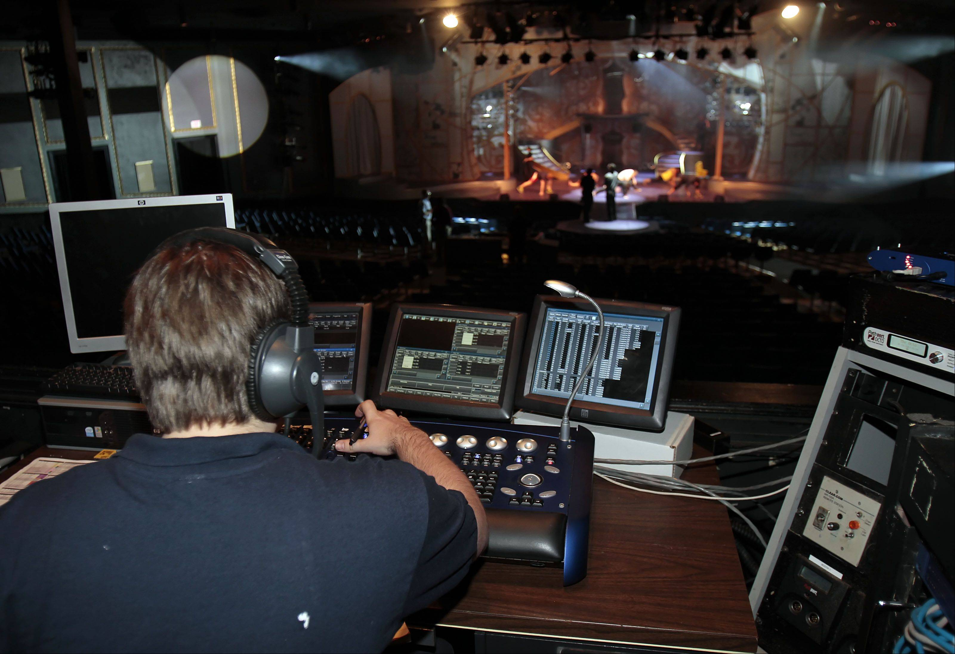 Lighting and sound operator Chris Payne of Racine, Wisconsin operates the lighting board during the production.