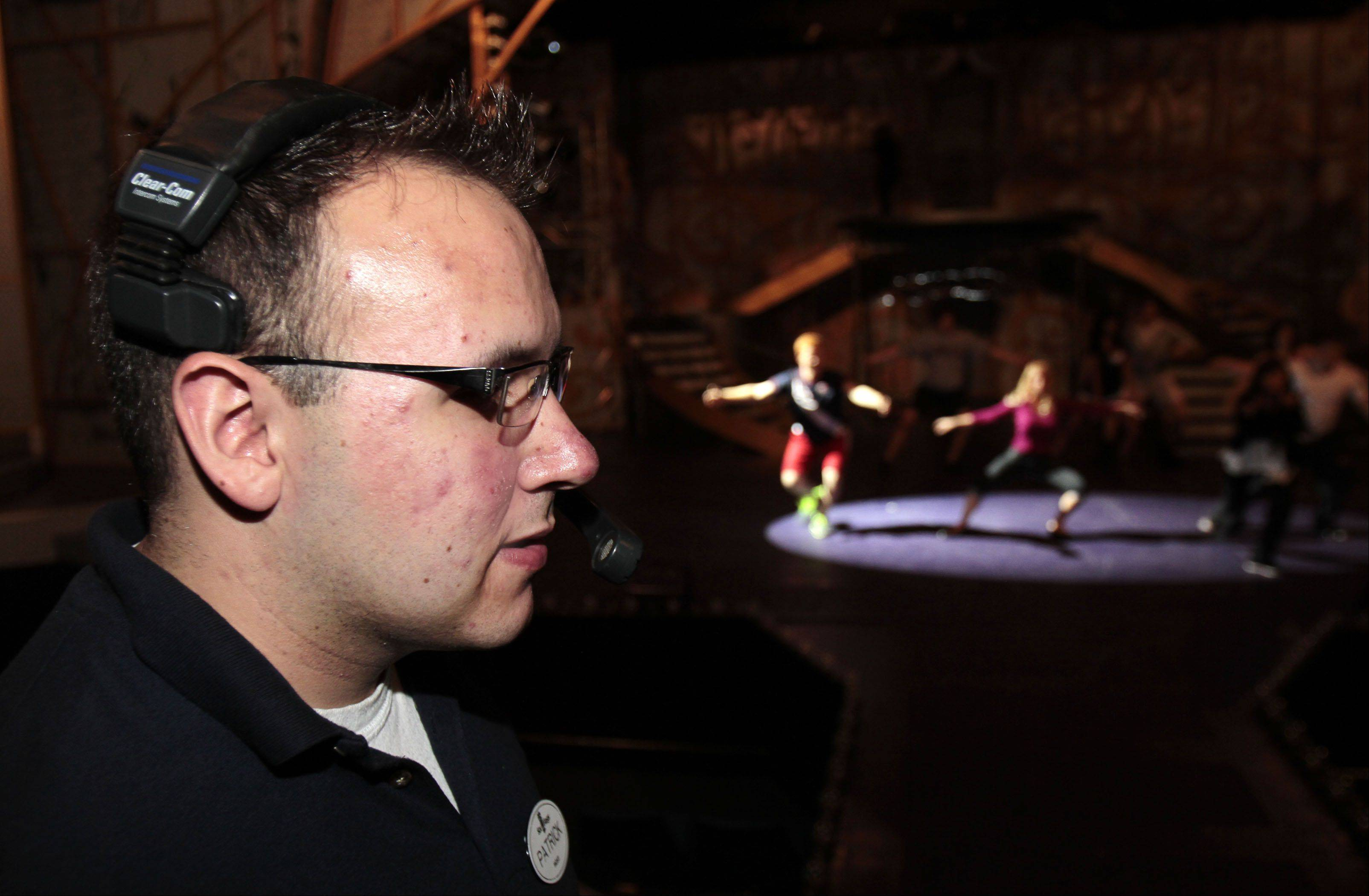 Technician Patrick Stewart of San Antonio, Texas checks the lighting as the cast members rehearse prior to the production of Pop Fusion.