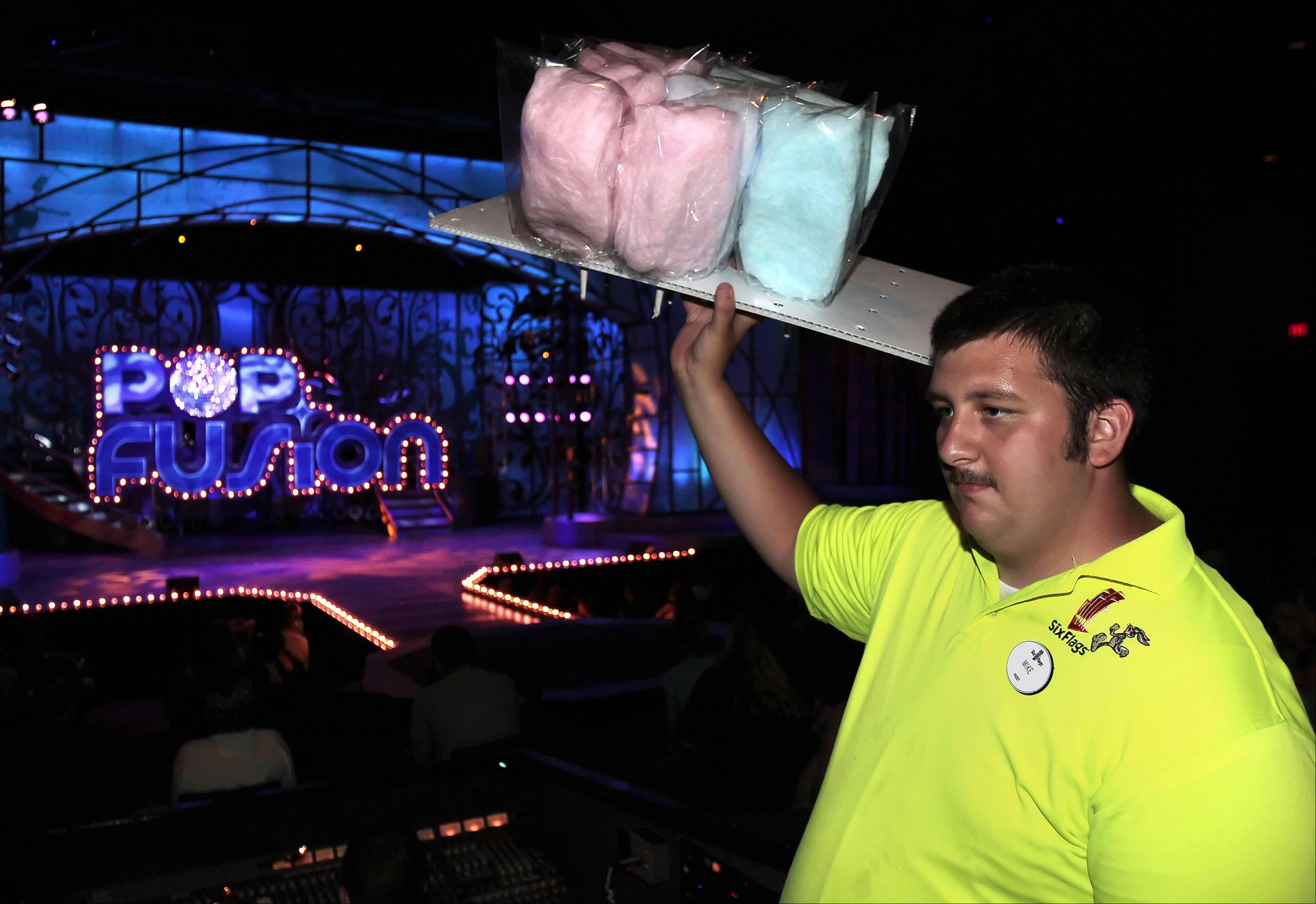 Mike Antunes of Gurnee sells cotton candy before Pop Fusion opens at Six Flags.