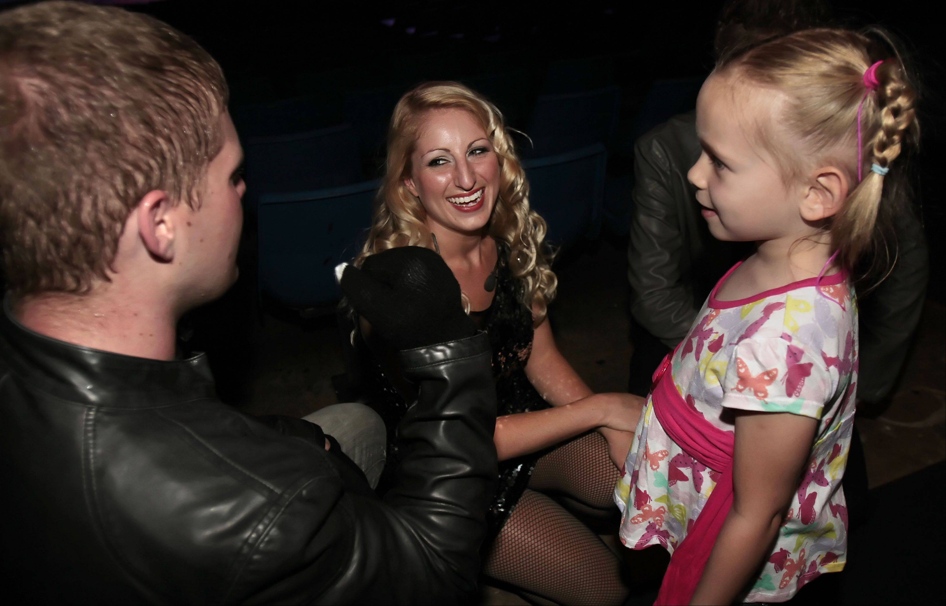 From left, cast members Connor See of Decatur and Charissa Hope of Chicago talk with 5-year-old Shaylyn Braun of Bristol, Wisconsin after the show.