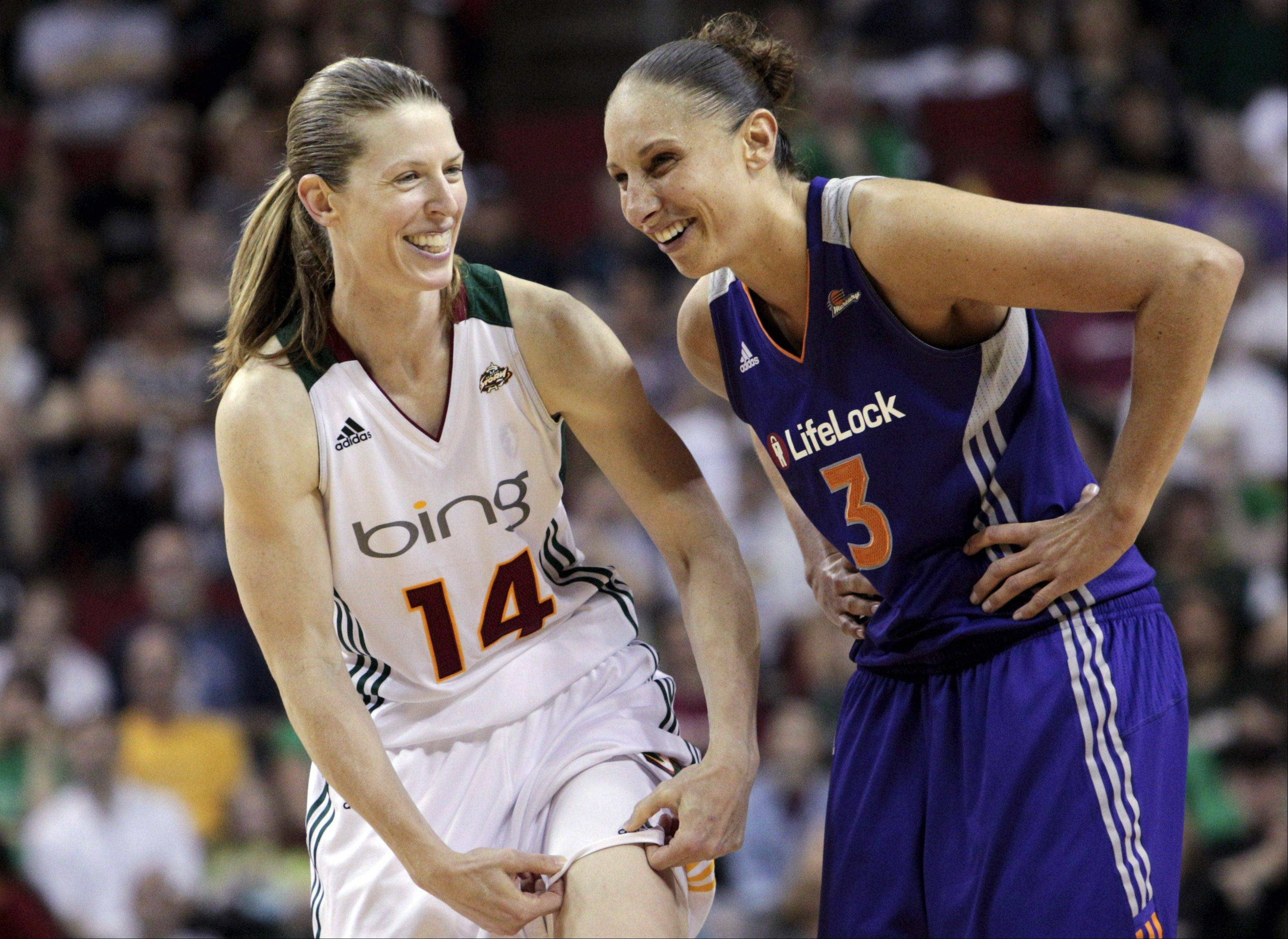Are women athletes too nice? Seattle Storm's Katie Smith (14) shares a recent laugh with Phoenix Mercury's Diana Taurasi, one of the more competitive stars in the league, during a game last month as a free throw was being shot. Patricia Babcock McGraw wants to know if you think women's teams would draw more attention and grow their sport if more athletes were edgier, nasty or polarizing, like some male athletes today.