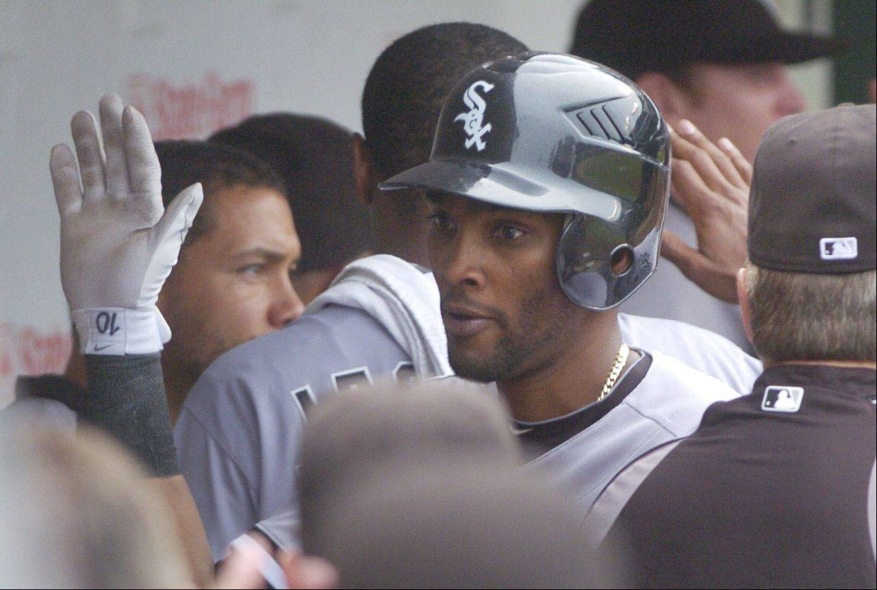 Alexei Ramirez of the White Sox is greeted by teammates in the dugout after his two-run home run during the seventh inning against the Cubs.