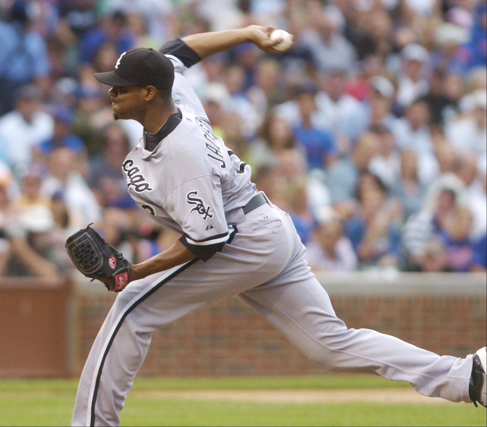 White Sox starting pitcher Edwin Jackson delivers against the Cubs during Friday's game.