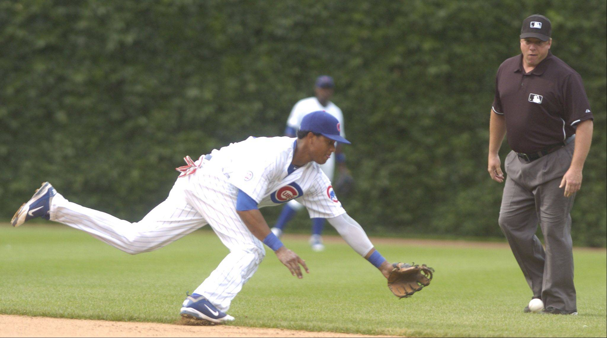 Cubs shortstop Starlin Castro tries to field a base hit by Alex Rios of the White Sox during the ninth inning.