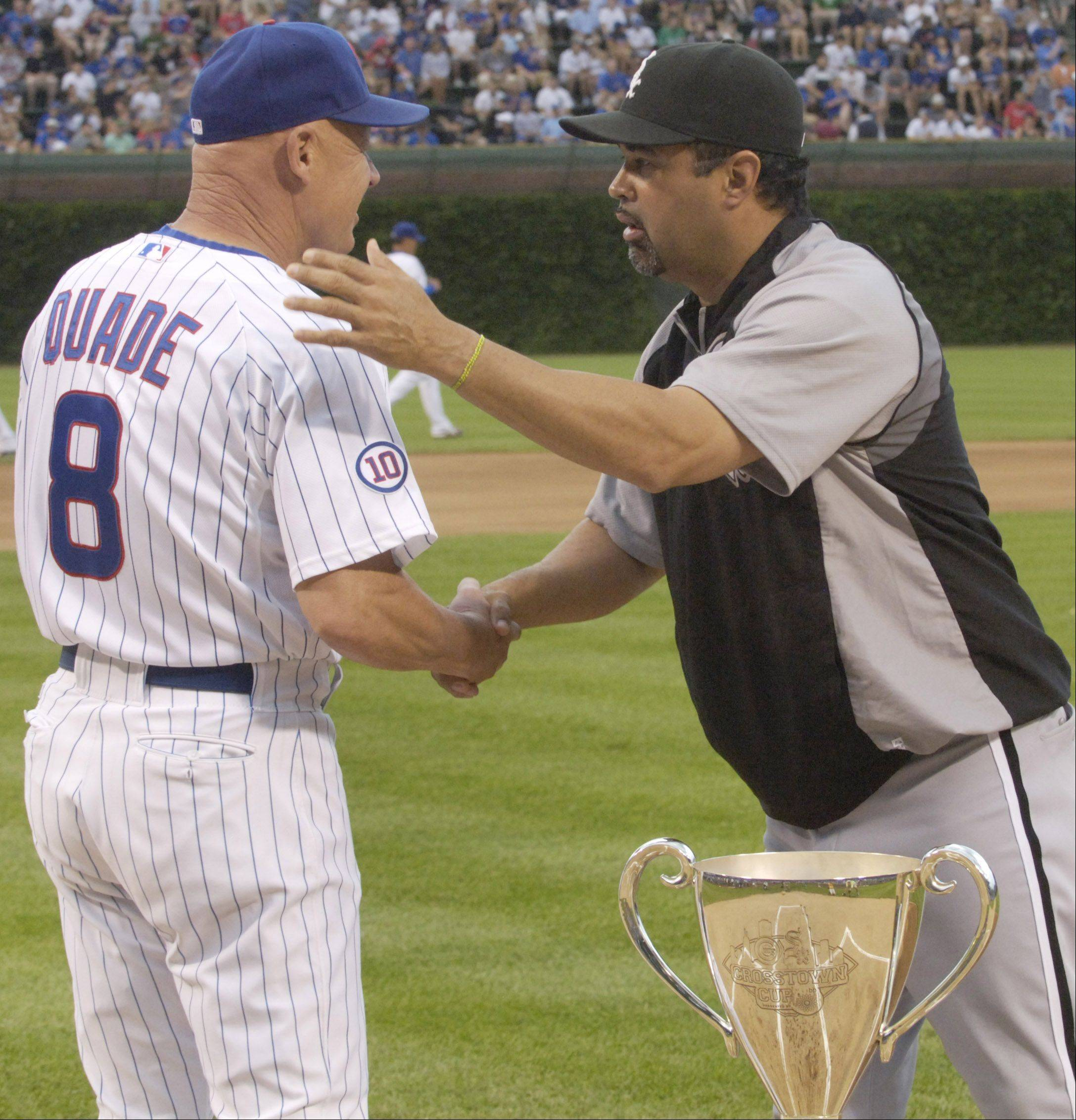 Cubs manager Mike Quade, left, and Sox manager Ozzie Guillen chat before Friday's at Wrigley Field.