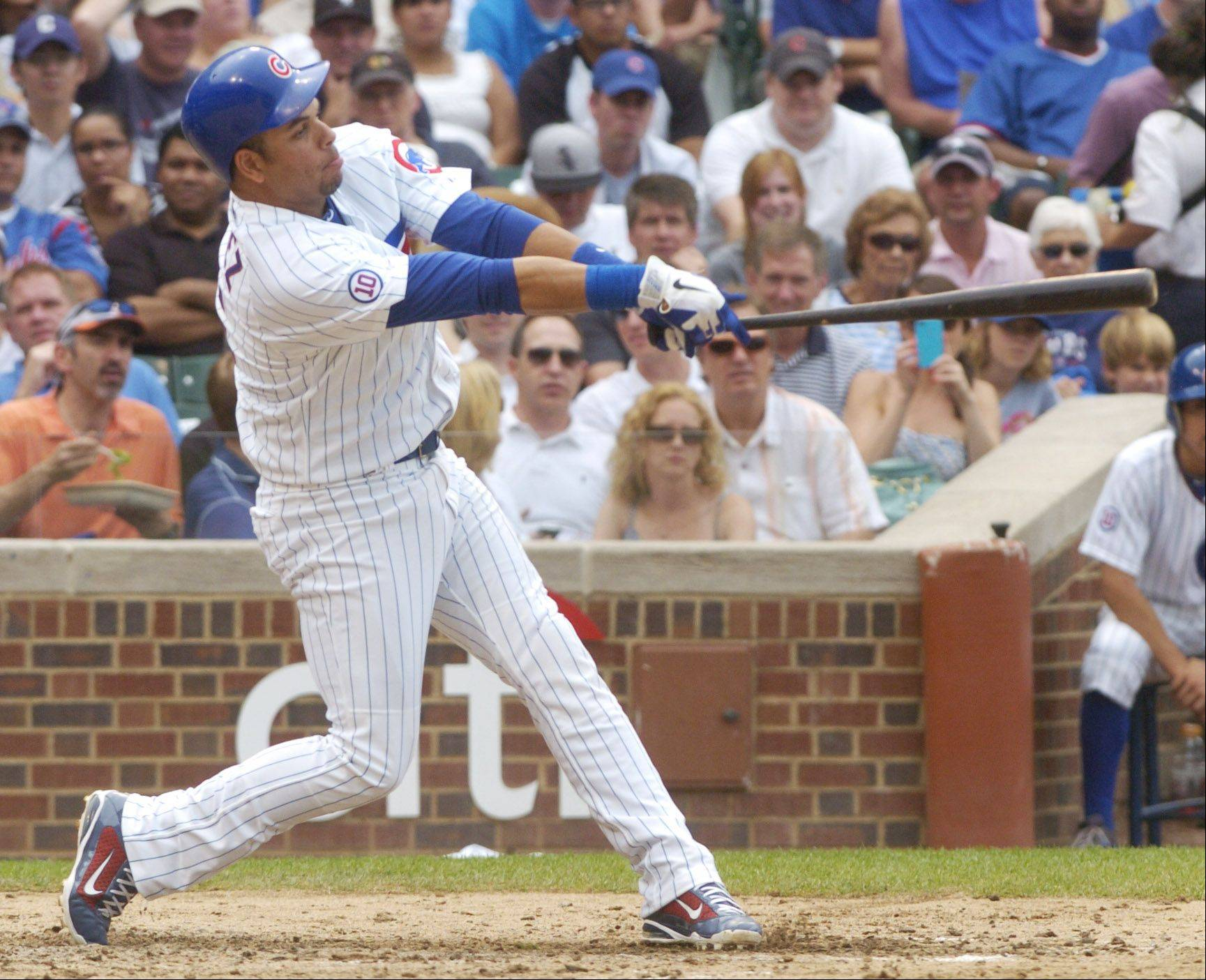 Aramis Ramirez of the Cubs hits a solo home run during the sixth inning against the White Sox.
