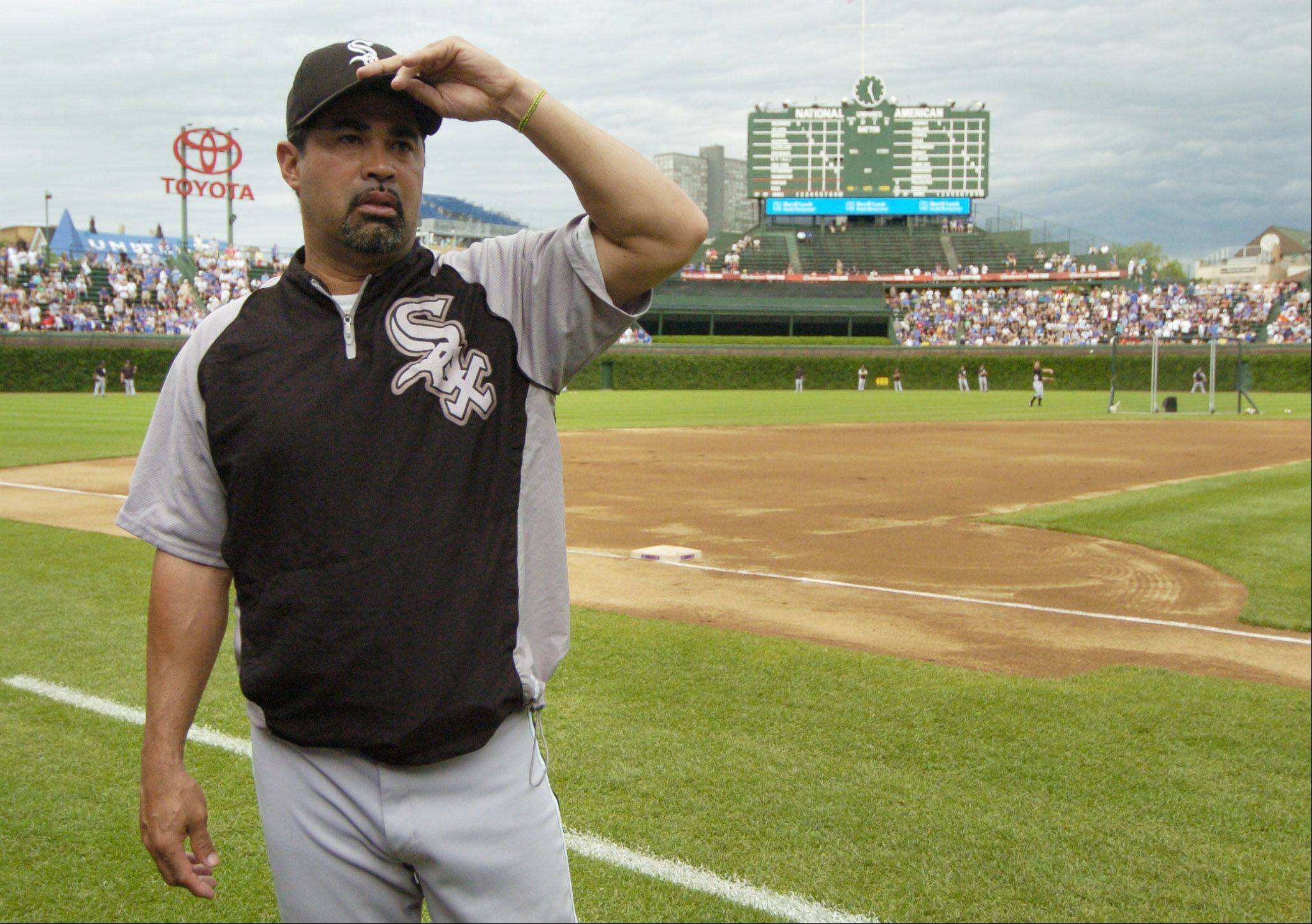 Chicago White Sox manager Ozzie Guillen awaits the start of Friday's game against the Cubs at Wrigley Field.