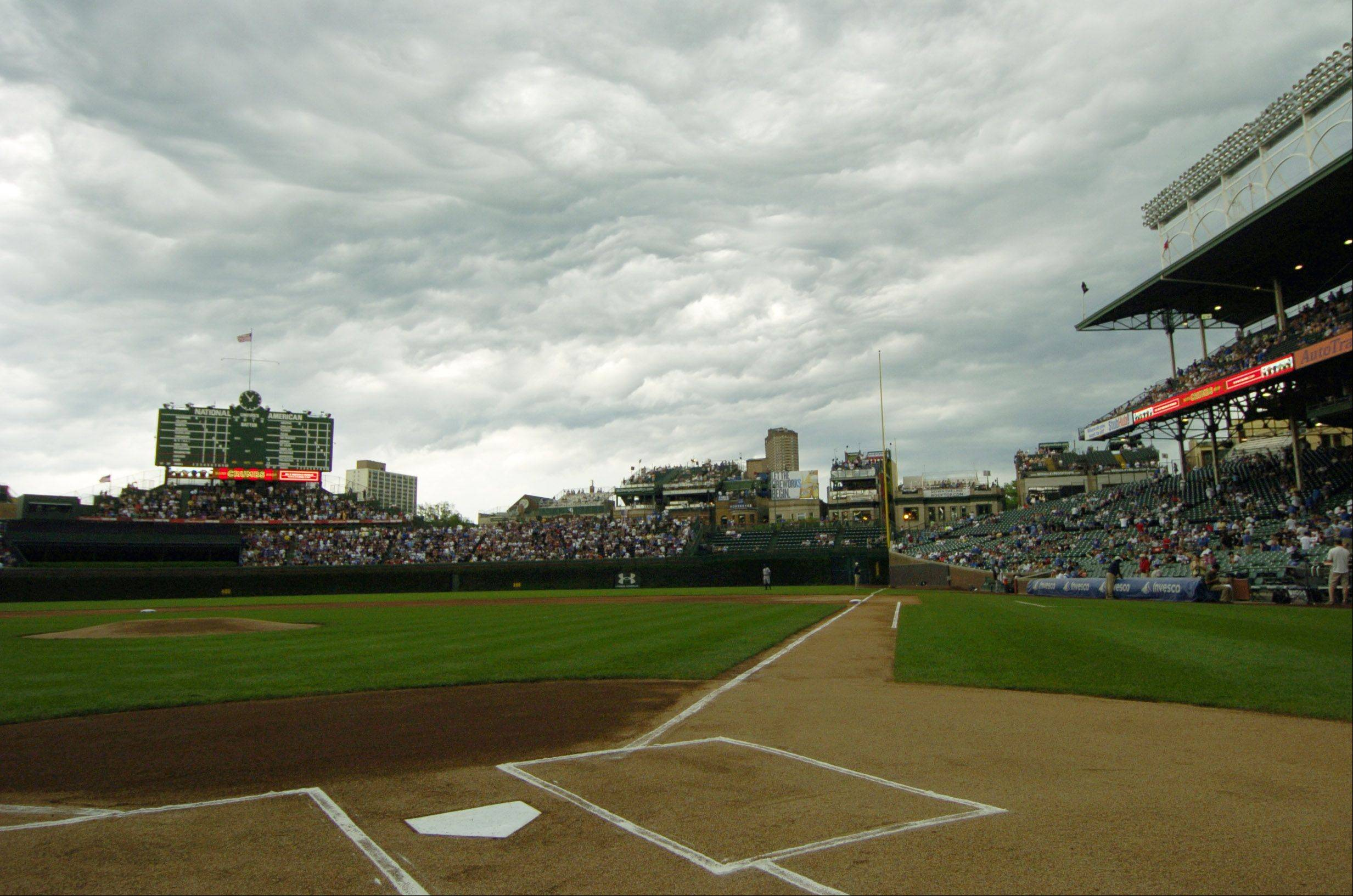 An ominous sky and strong winds pass over Wrigley Field before game time Friday.