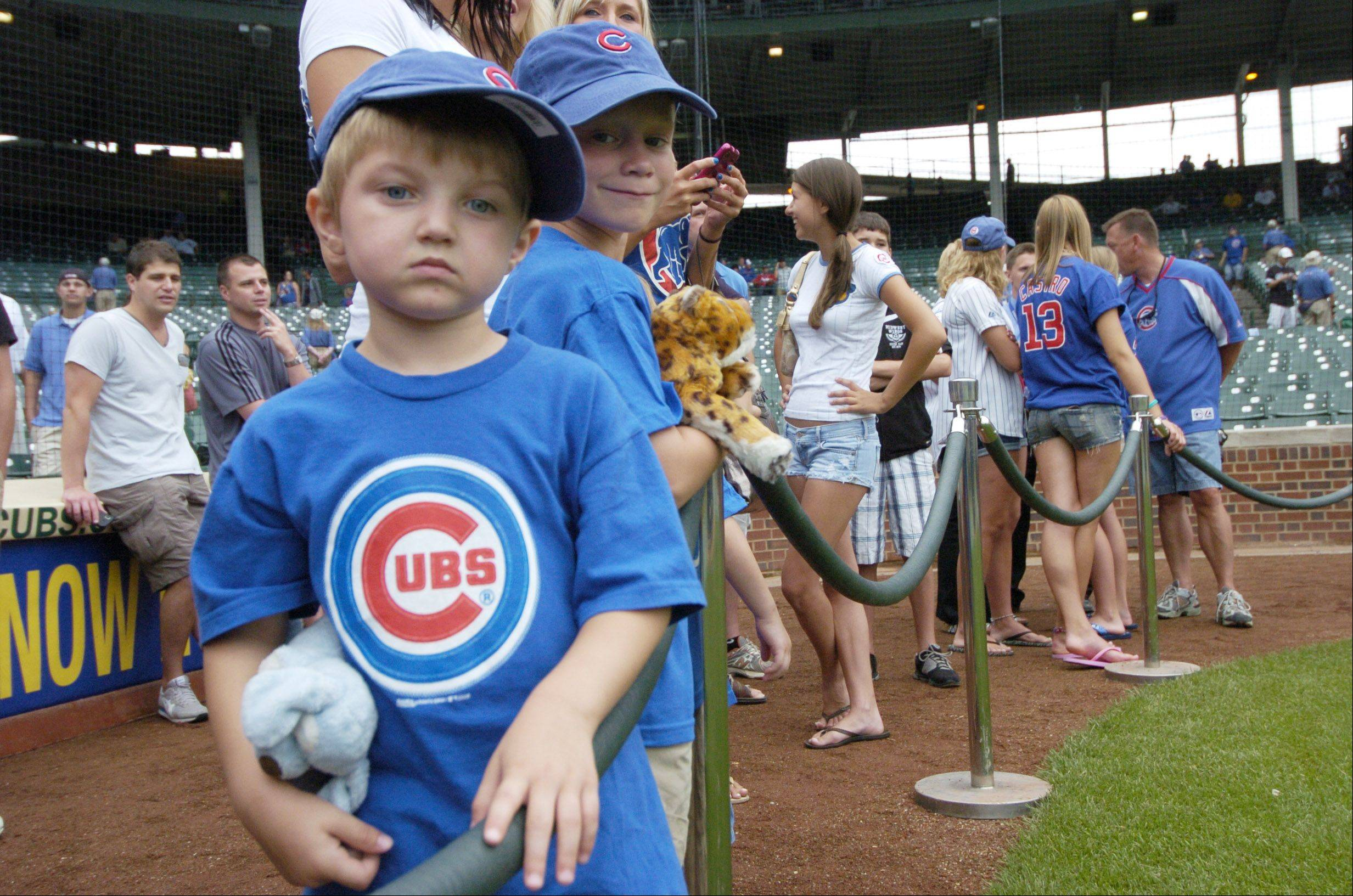 Jaydyn Foley, 3, of Burr Ridge waits in the Kid's Corral for a player's autograph before Friday's game between the Cubs and Sox at Wrigley Field.