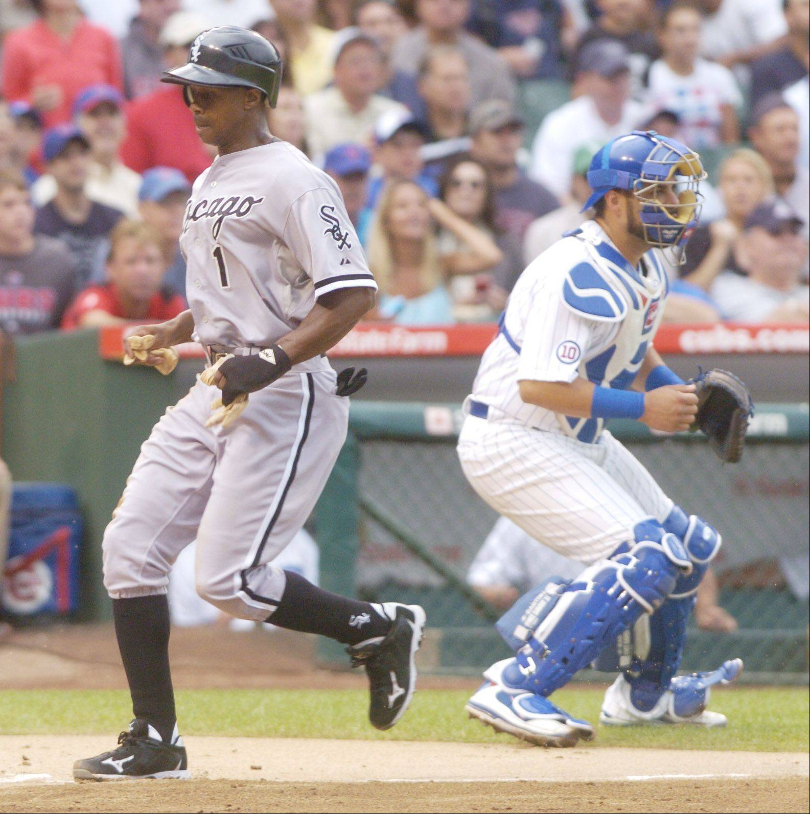 Juan Pierre of the White Sox scores during the first inning against the Cubs.