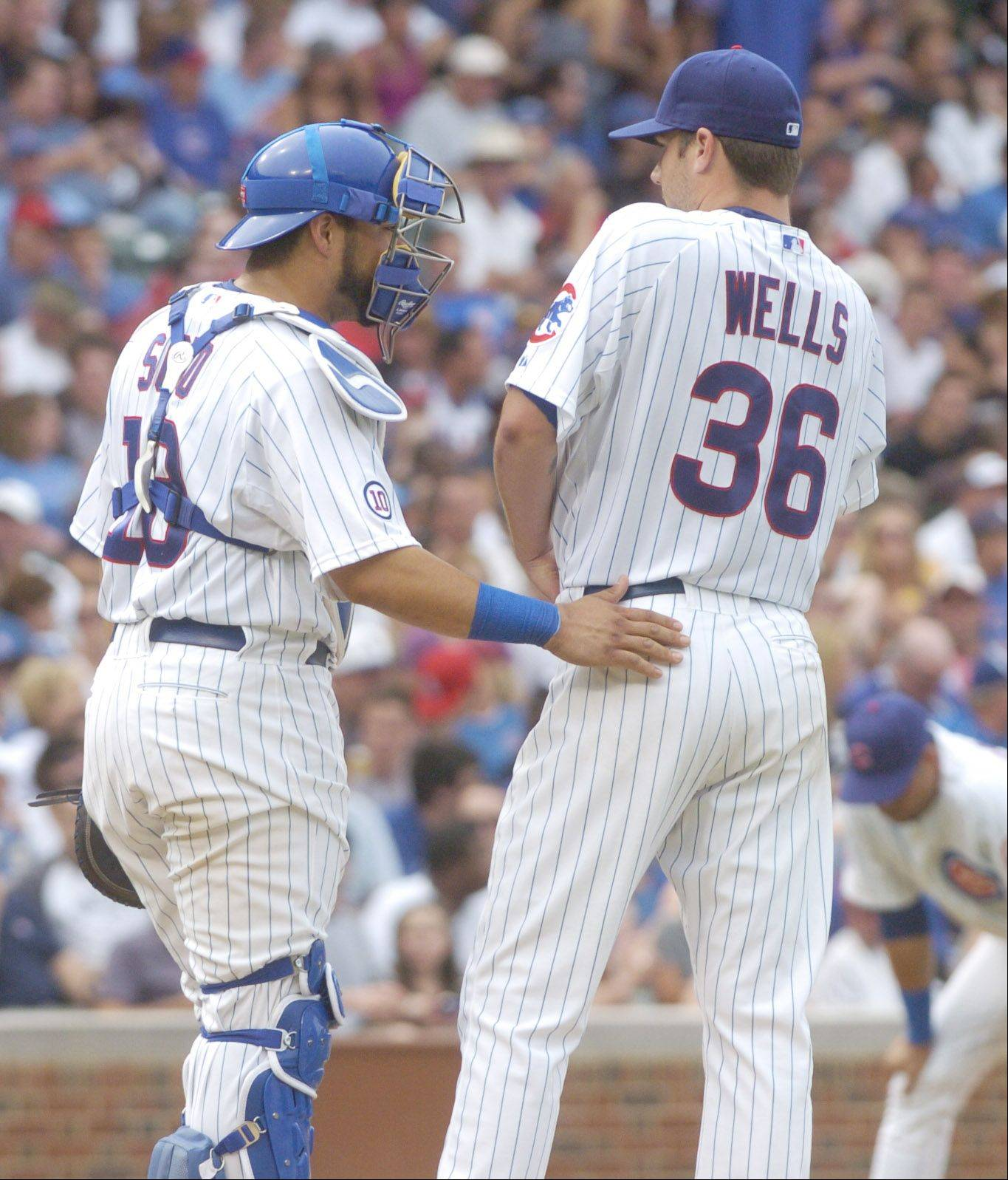 Cubs catcher Geovany Soto tries to settle starting pitcher Randy Wells during the White Sox' four run-seventh Friday.