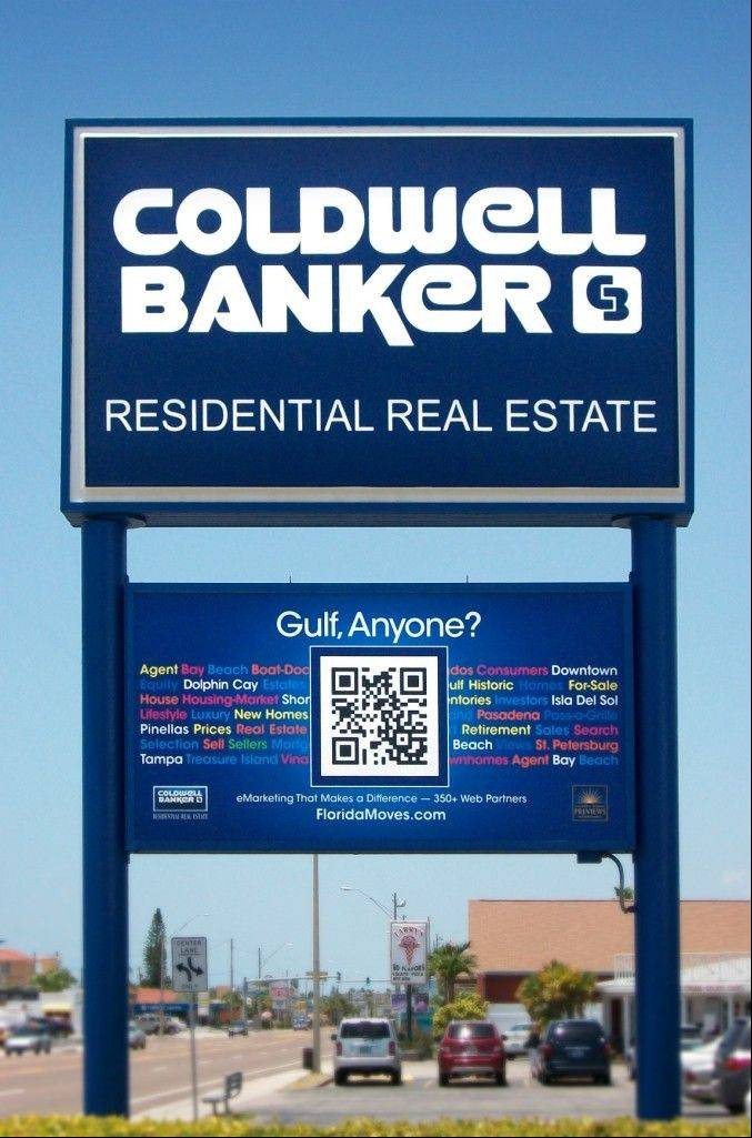 Coldwell Banker, a real estate sign located in St. Petersburg, Fla., using a Quick Response code, the small square with black dots and lines in the bottom half of the image, to draw business. Anyone walking or driving by can use a smartphone loaded with a QR code app to scan the box. Their phone will then take them to a Coldwell Banker website with real estate listings and agent profiles.