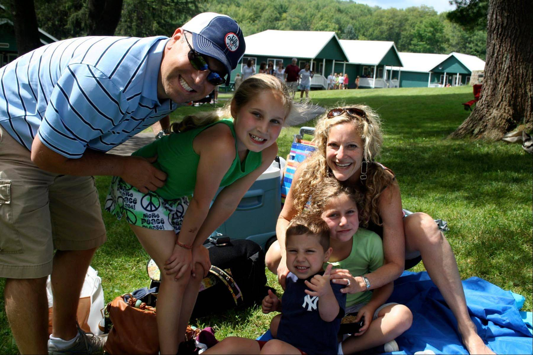 The Goldman Family as they visit daughter Sam, second from left, during visitors day at Camp Wayne for Girls in Preston Park in Wayne County, Pa.