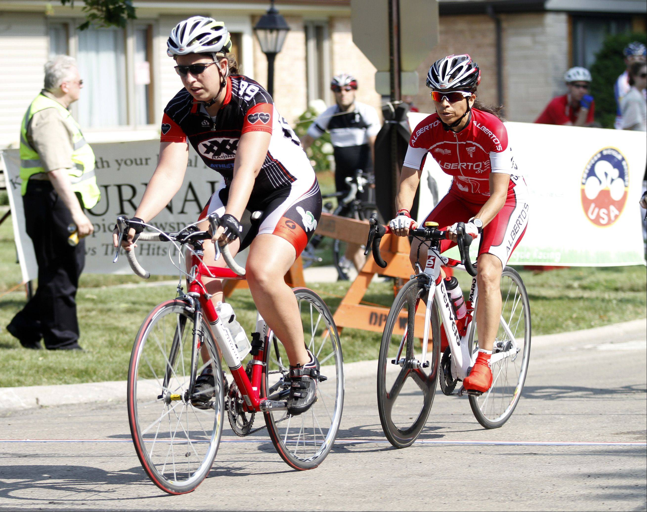 Megan Burke, front, makes a lap on Saturday during the Women Category 4 & 5 race of the �Tour De Villas� in Des Plaines.