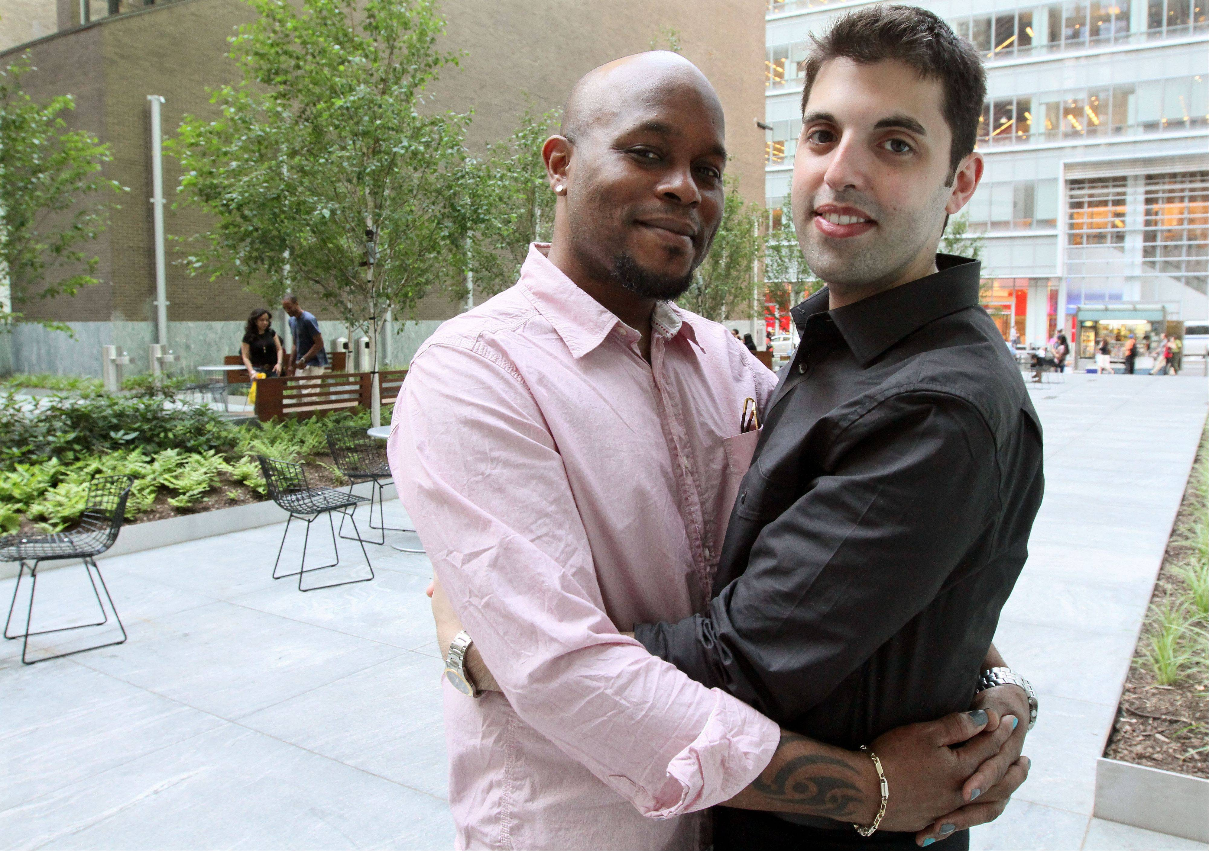 Darren Major, left, and his husband Andrew Troup live in New York and were legally wed in Canada in 2008. As gay marriage becomes legal in New York, companies and individuals are wrestling with changes to their fin
