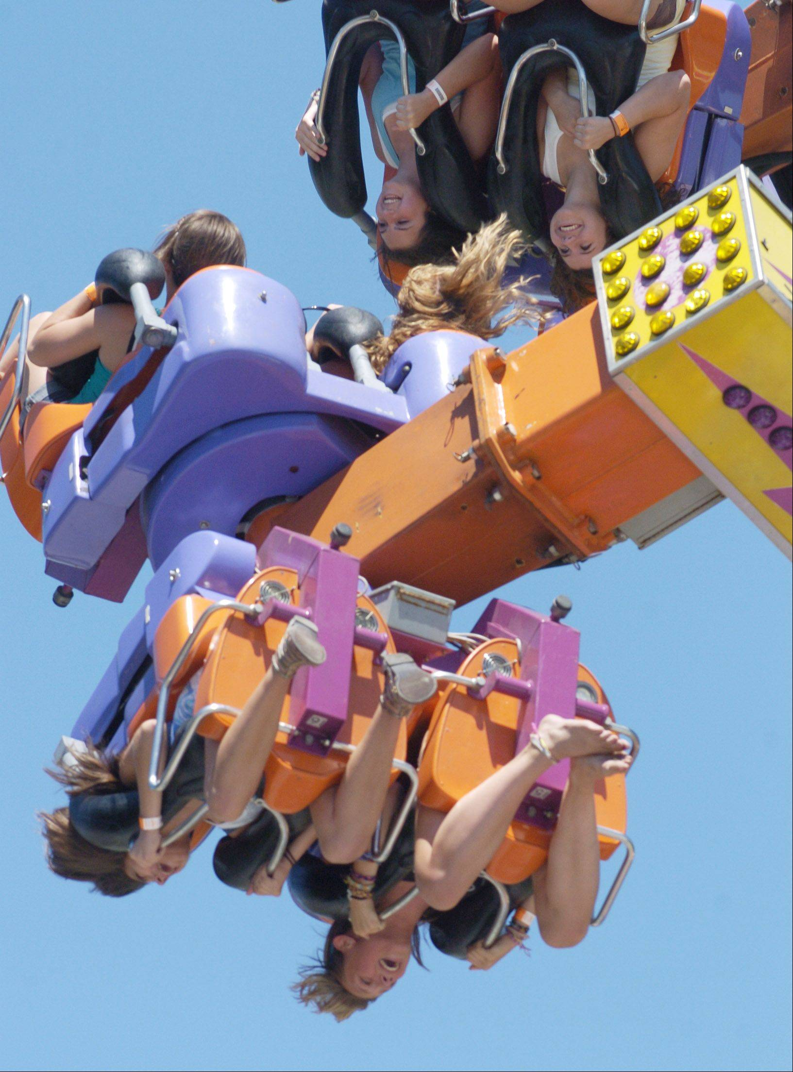 Teens take a ride upside down during last year's Frontier Days in Arlington Heights.