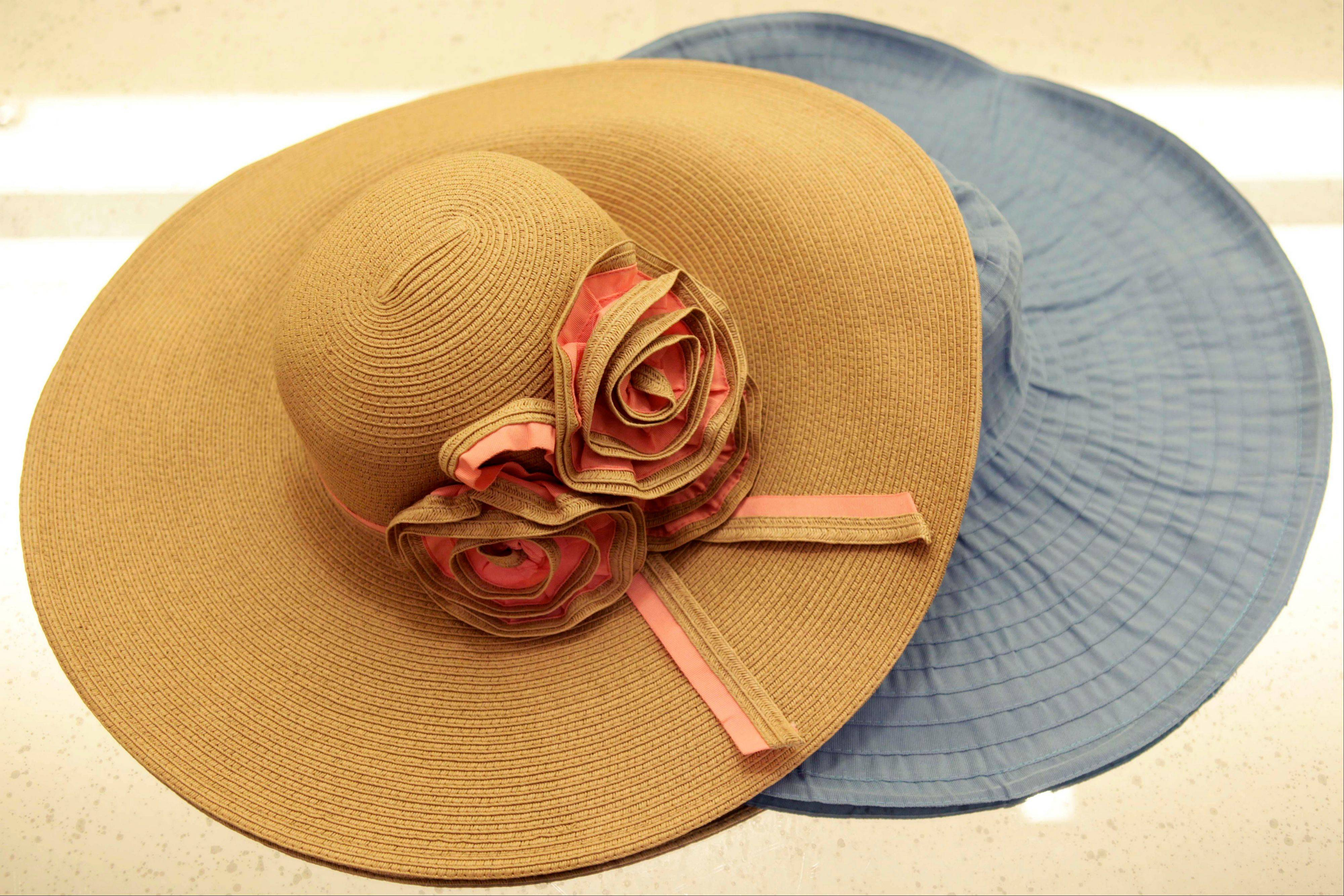 Hats by Badgley Mischka at their studio in New York would work well at upscale summer parties.