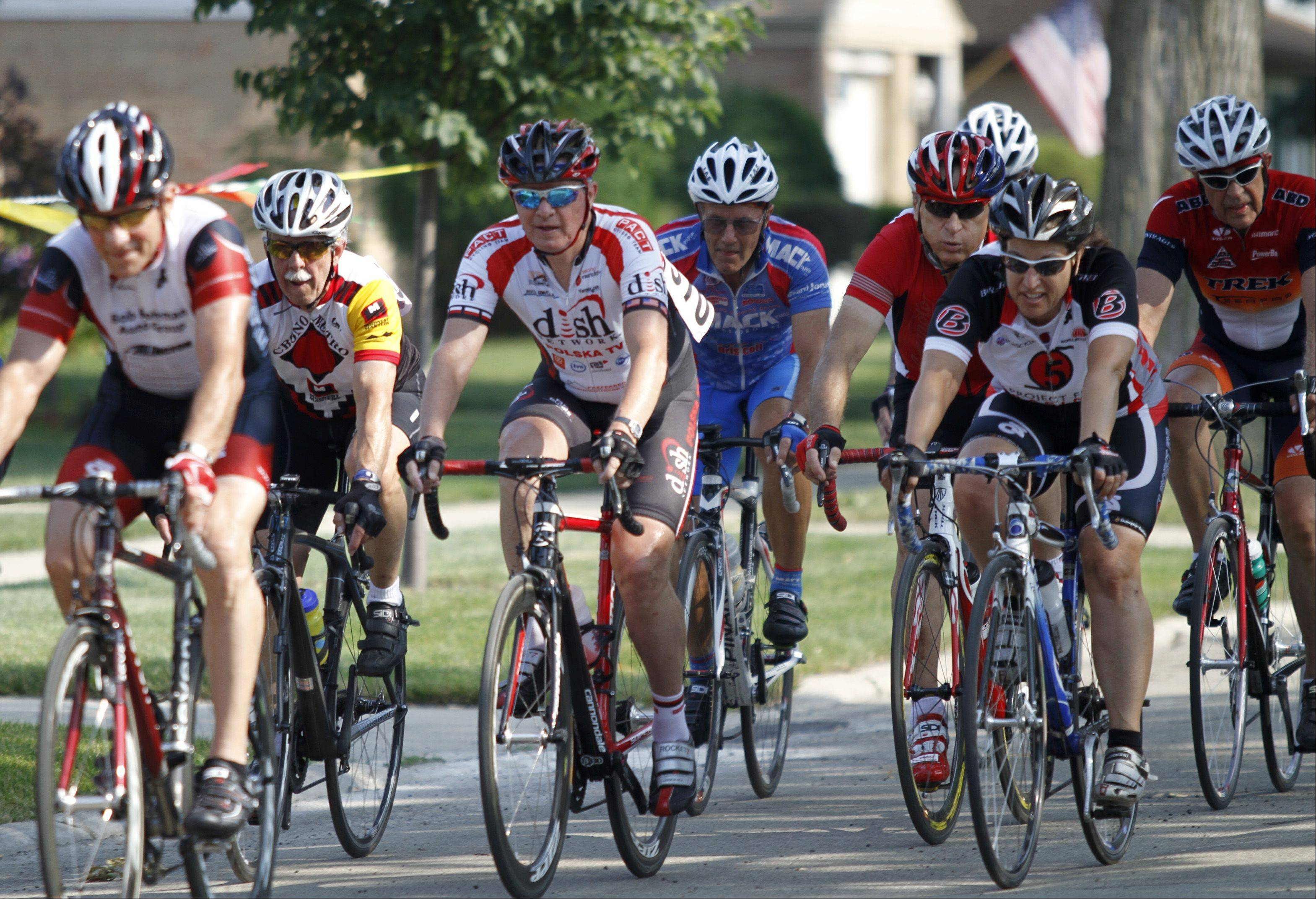 "Participants of the masters 60, 65, 70, 75, 80+ category of the ""Tour De Villas"" race Saturday morning in Des Plaines. Bicyclists from around the area participated in the second annual bike race."