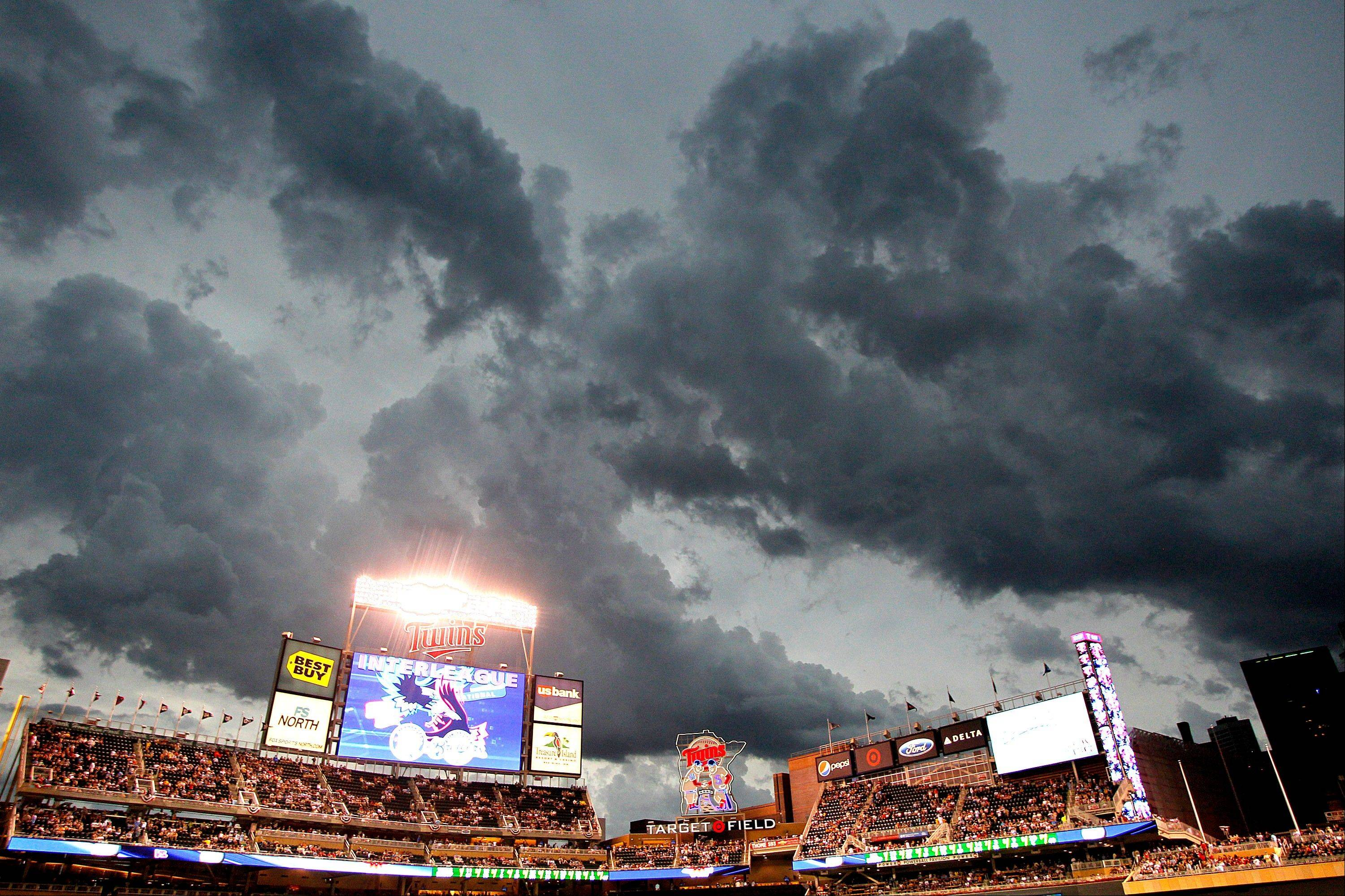 Storm clouds hover over Target field Friday, delaying the baseball game between the Milwaukee Brewers and the Minnesota Twins.