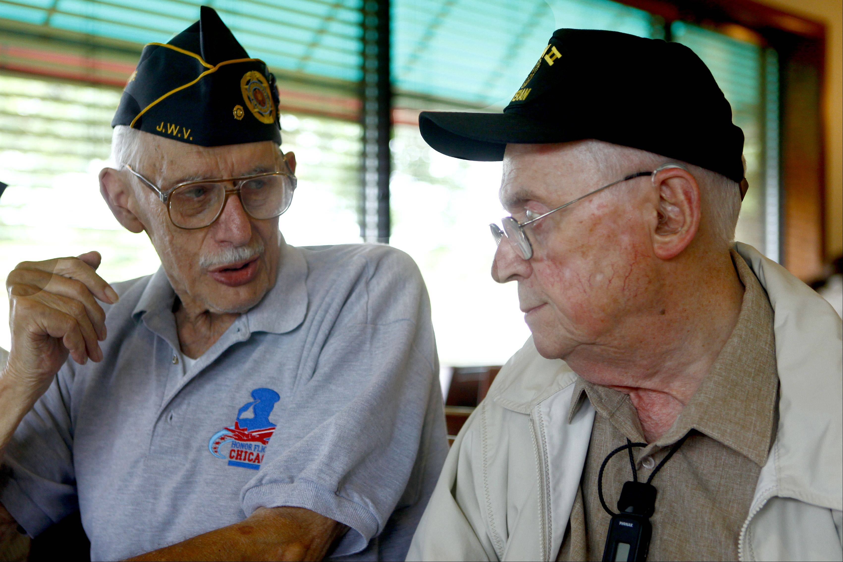 Milton Davis, left, of Wheeling talks with Joe Groner of Northbrook about their time in the service and the Honor Flight for World War II veterans they made Wednesday to Washington.