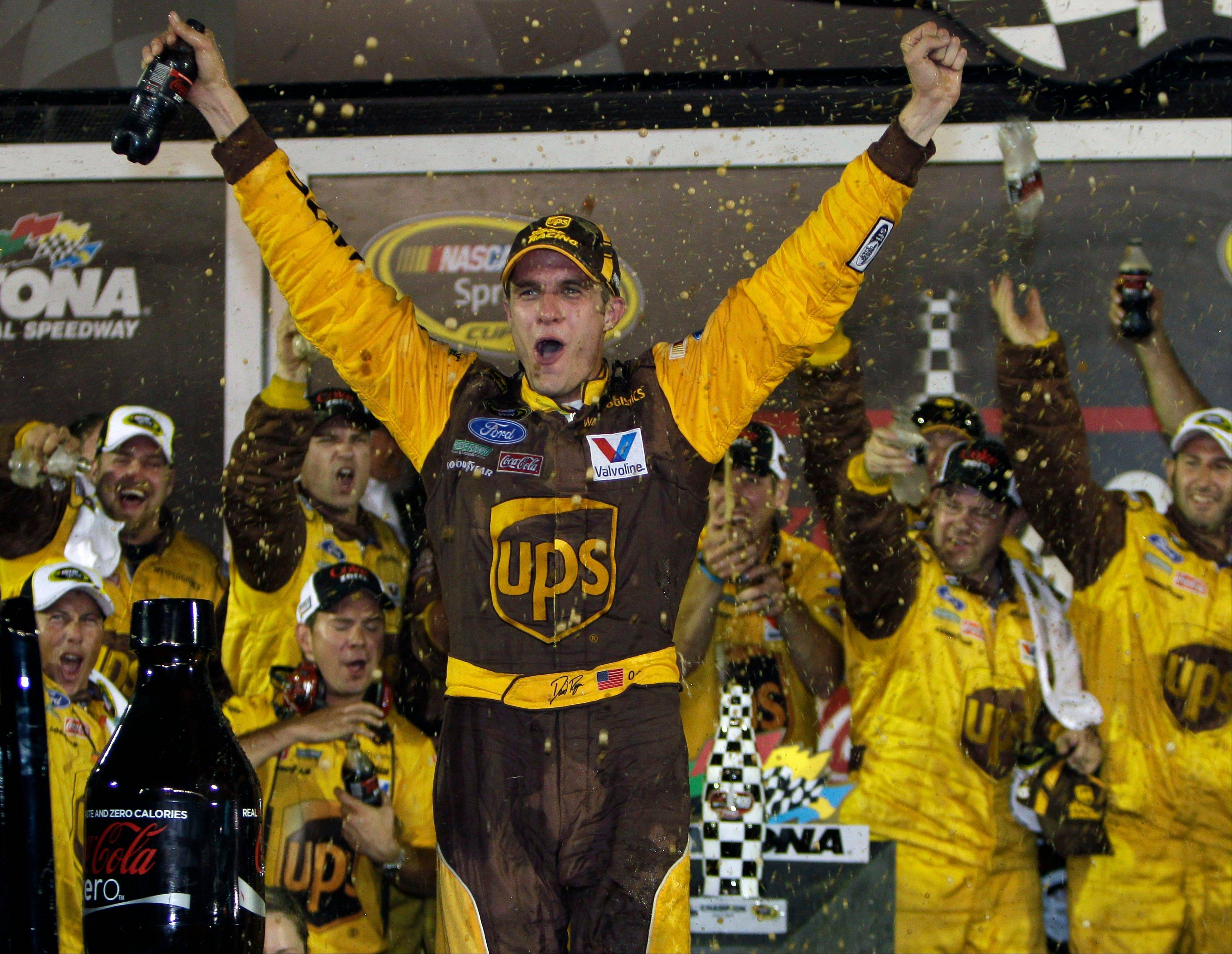 David Ragan celebrates after winning the NASCAR Coke Zero 400 in Daytona Beach, Fla., on Saturday.