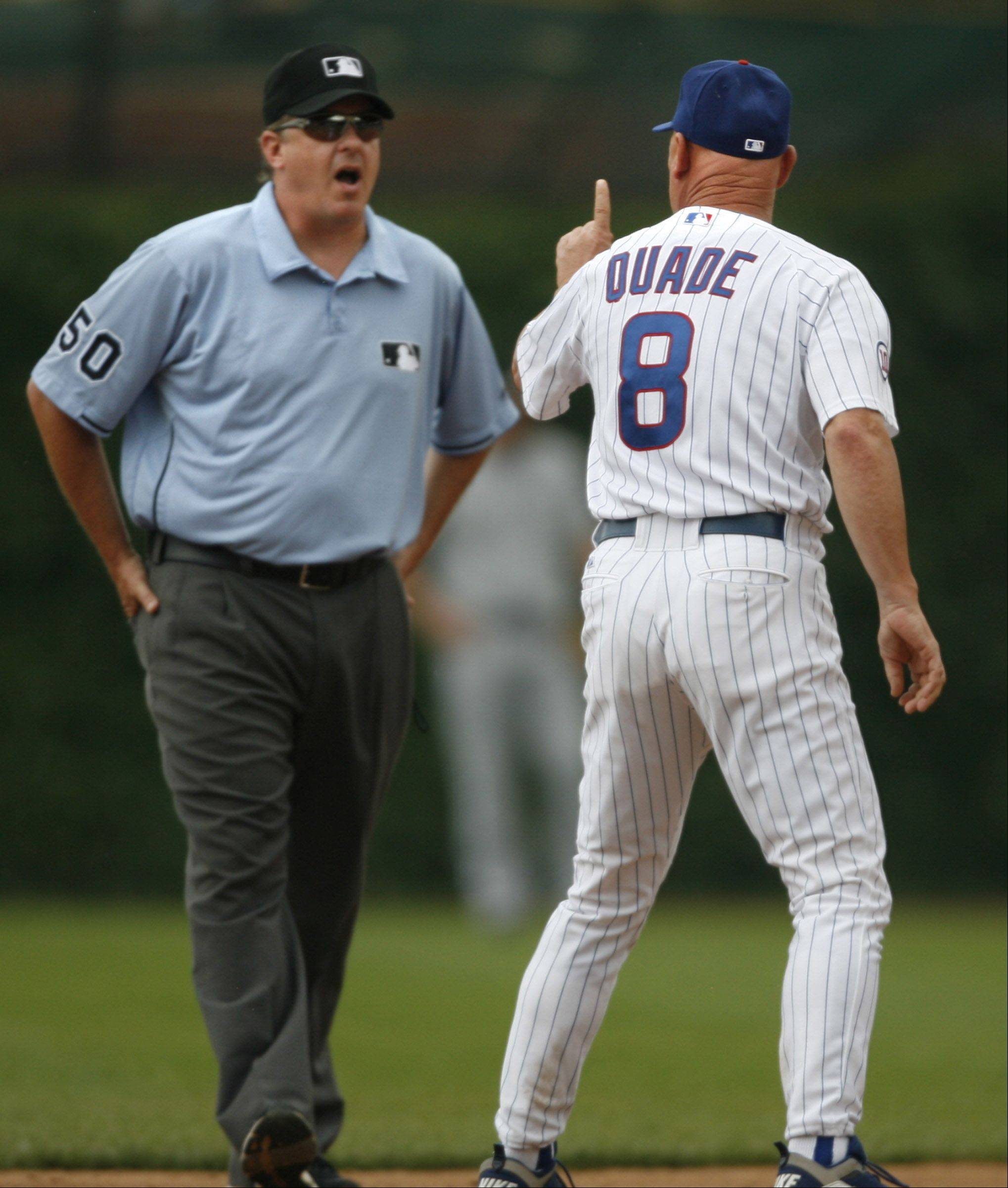 Cubs manager Mike Quade continues to argue after being by second-base umpire Paul Emmel in the second inning Saturday.