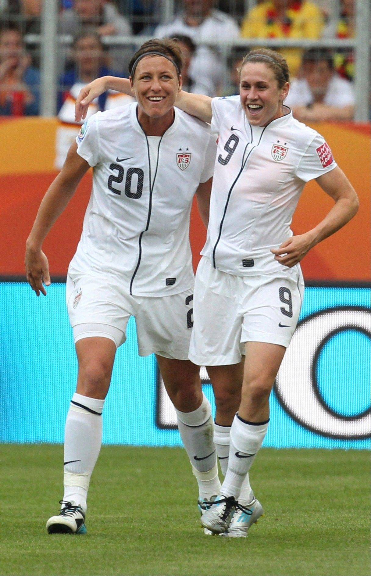 Abby Wambach, left, celebrates after teammate Heather O'Reilly scored the opening goal during the United States' 3-0 victory over Colombia on Saturday in World Cup play in Sinsheim, Germany.