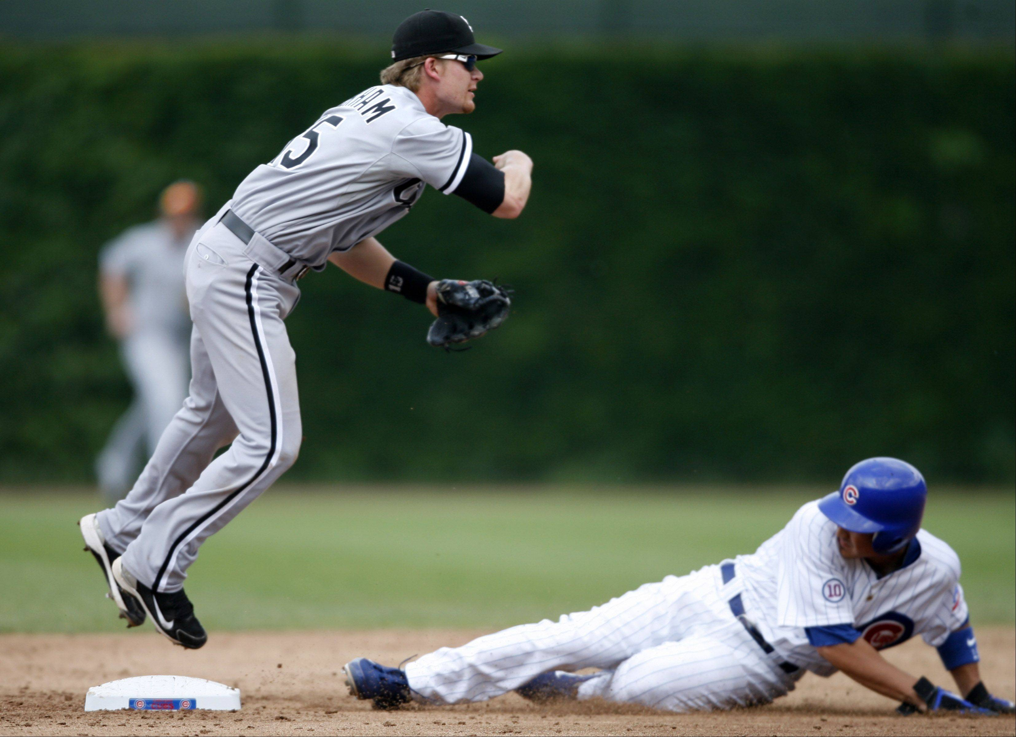 White Sox Gordon Beckham throws to first as Cubs Darwin Barney is out at second for a inning ending double play at Wrigley Field on Saturday.