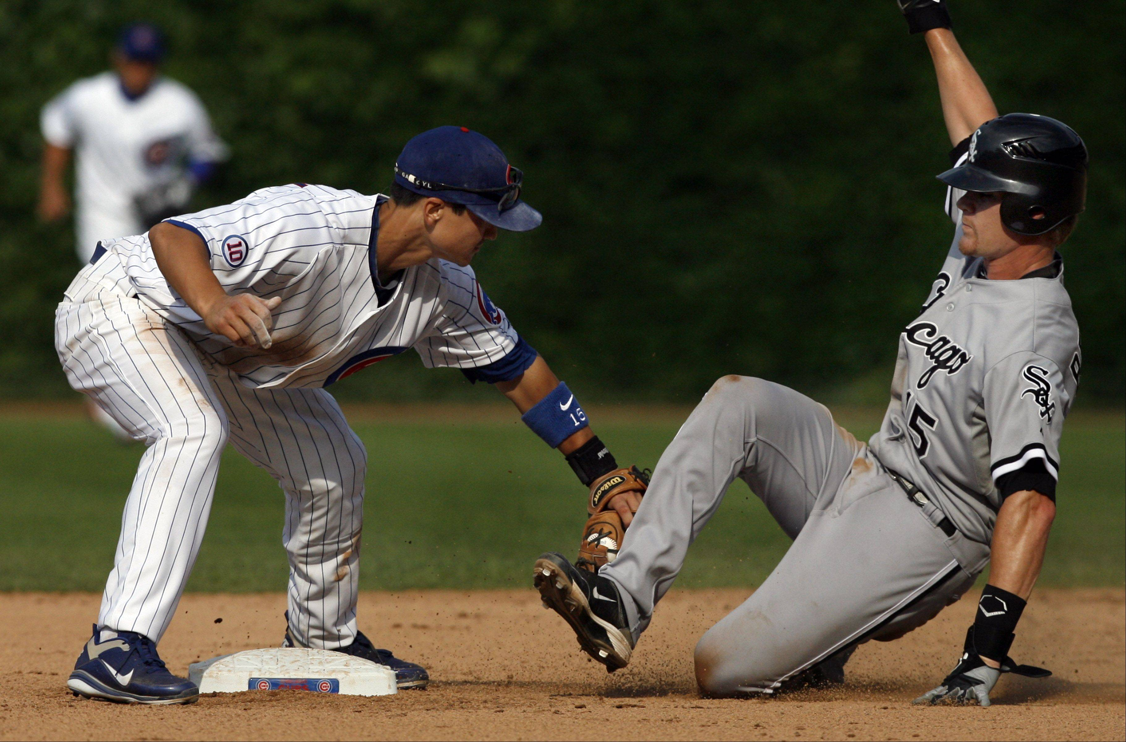 Cubs Darwin Barney tags White Sox Gordon Beckham out at second as Sox win 1-0 at Wrigley Field on Saturday.