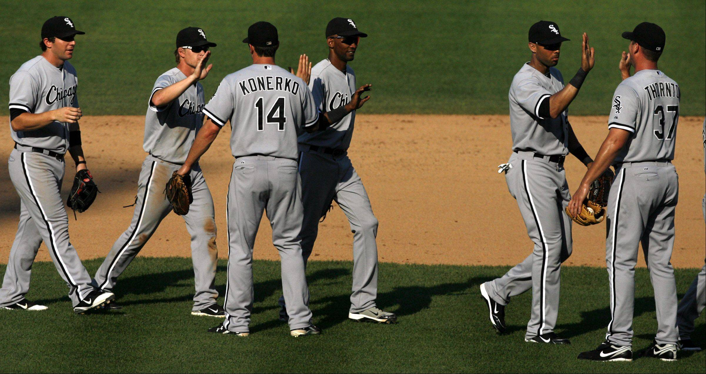 White Sox celebrate 1-0 win over the Cubs at Wrigley Field on Saturday.
