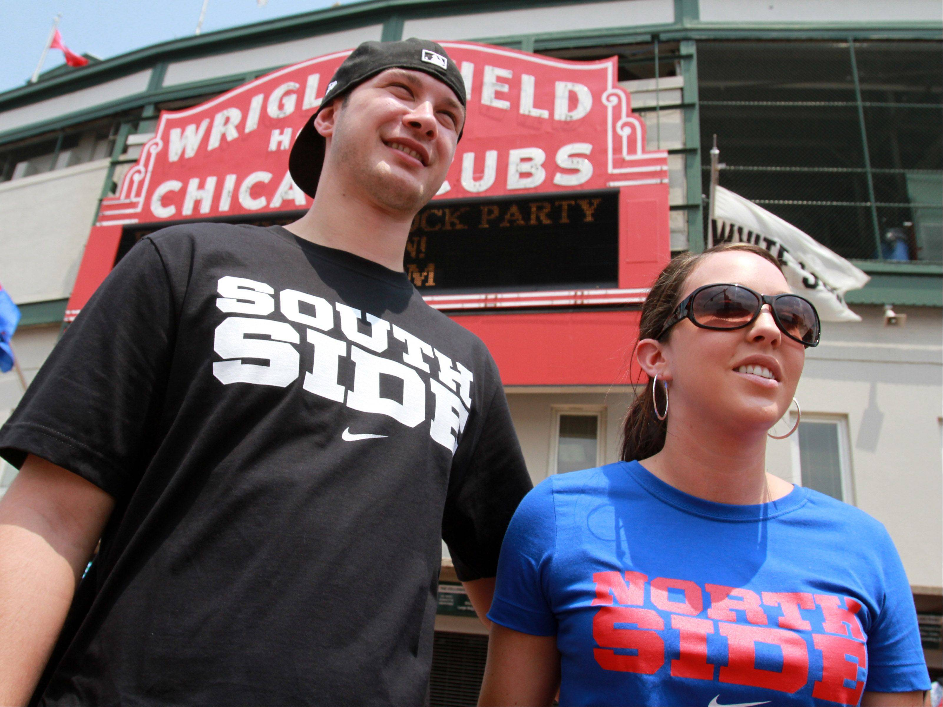 White Sox fan Joseph Halkinrude of Palatine and his wife Cubs fan Kim before the game at Wrigley Field on Saturday.
