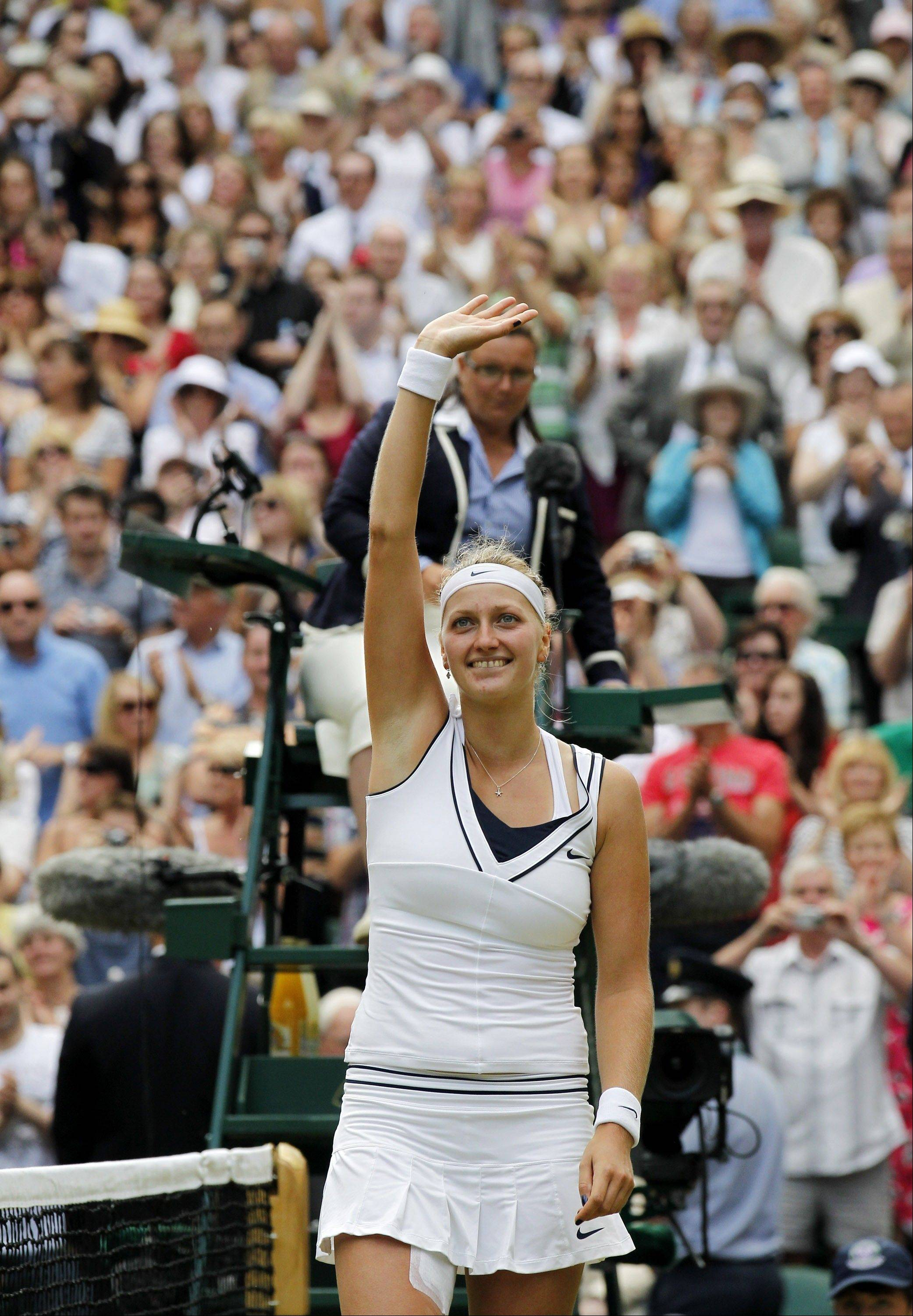 Petra Kvitova of the Czech Republic celebrates defeating Russia's Maria Sharapova in the ladies' singles final at the All England Lawn Tennis Championships at Wimbledon, Saturday, July 2, 2011.
